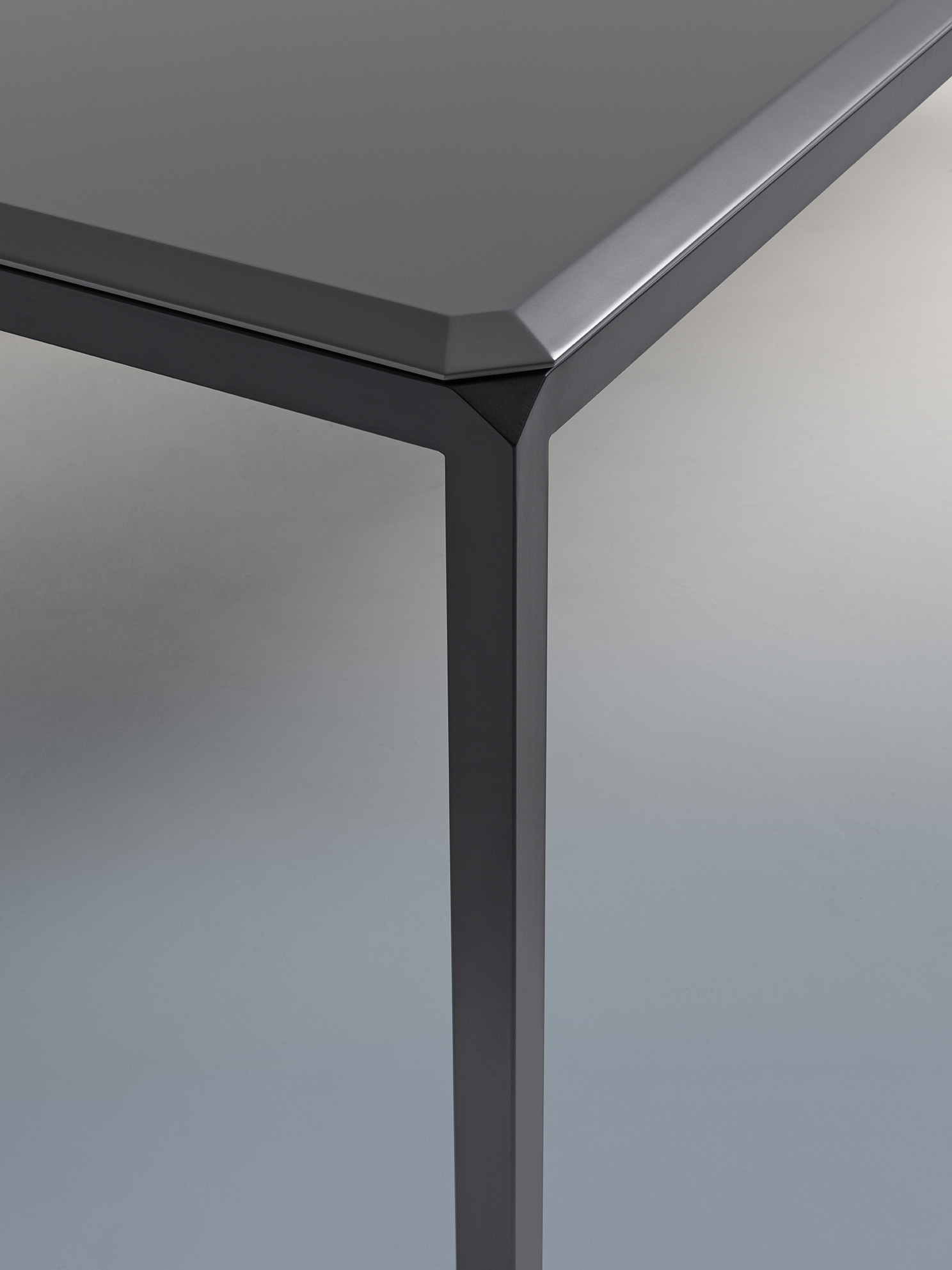 Bebop Dining Table - The Bebop table stands out for the attention to detail, quality workmanship, and the contrasting industrial iron frame and fine marble or lacquered top. It has a steel structure, with a top in marble or lacquered wood featuring four rounded corners that give boldness to details. The larger table has top options only in Scratchproof Lacquered MDF, Bianco Michelangelo Marble and Calacatta Oro Marble. A range of materials, colours and finishes are available in a number of combinations.    | Matter of Stuff