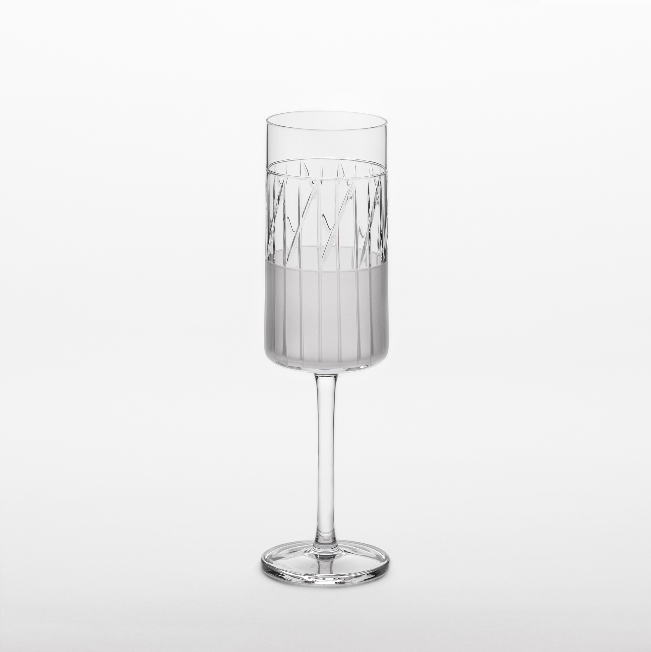 "Element Champagne Glasses - Set of 2 - A rich assemblage of graphic markings defines the ""ELEMENTS"" series of lead crystal. Cuts and textures of varying depth and intensity are employed across glasses to create a landscape of layered pattern that is fresh and seductive; a whole new take on the decoration of cut crystal.