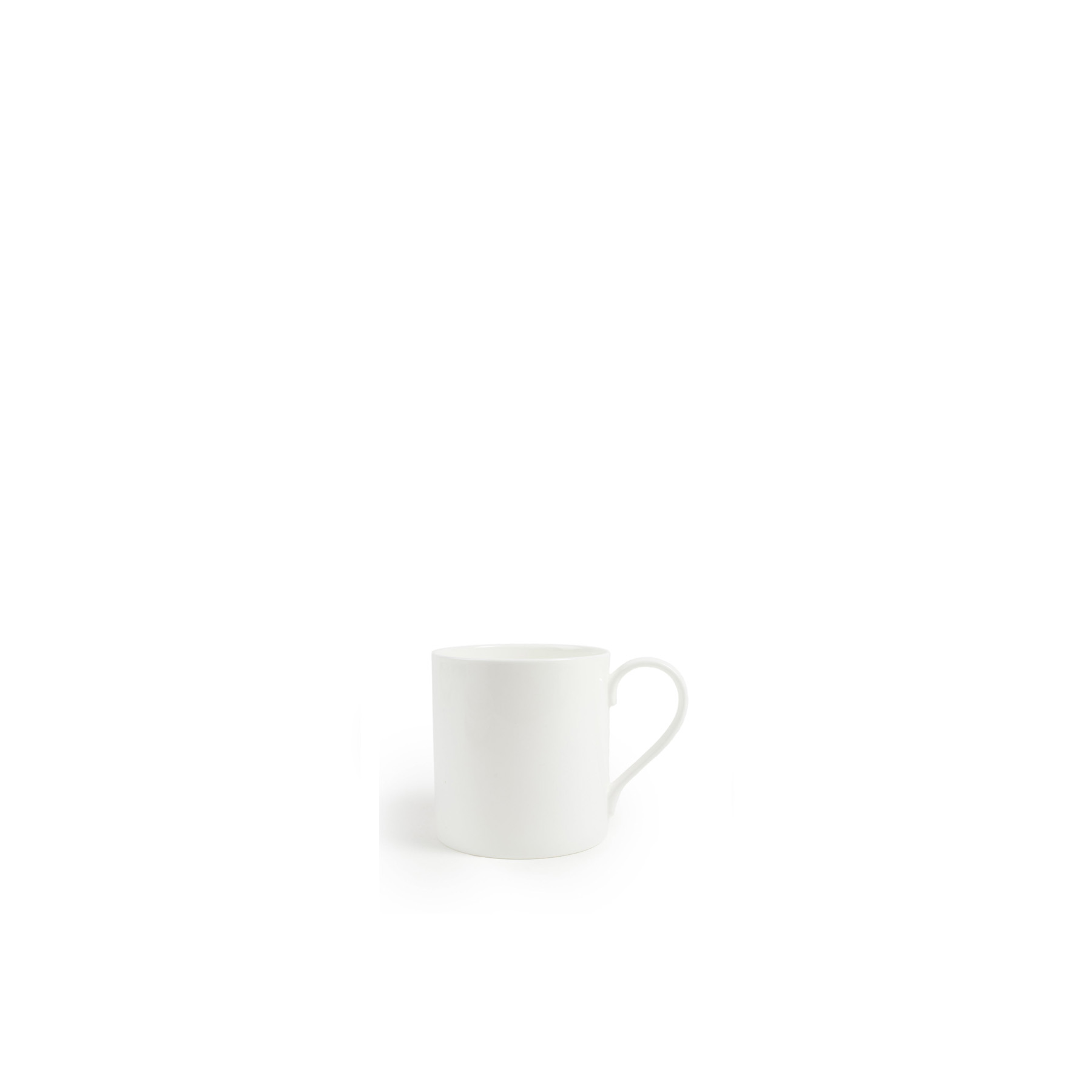 White Mug - The purist fine bone china table ware. Designed by Chris Johnson and made in Stoke-on-Trent. This forms the base of all our collections and the most wonderful foundation for any table.