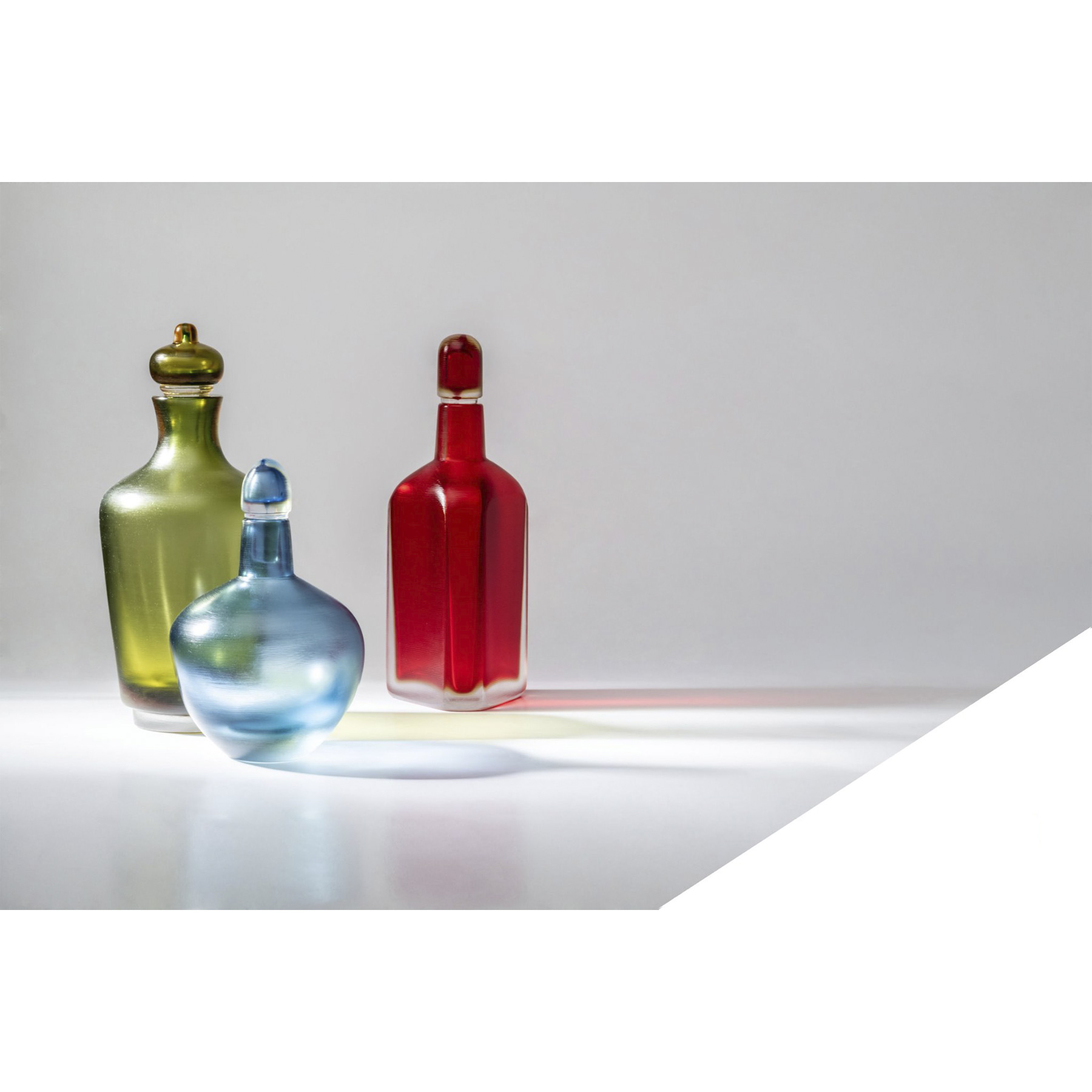 """Bottiglie Incise Set of 4 Bottles - <p>Part of the """"Incisi"""" collection, they are named after a complex and sophisticated technique. This glass is cold-engraved with gentle colours, refined and subdued. They invite you to lightly caress them. A multitude of shapes and colours. Apparently, Paolo Venini had a knack for experimenting with Incisi. Bottiglie Incise showcase a multitude of shapes and colours. Every bottle has its own, chosen with care by Paolo Venini in 1956. Skilfully etched to conceal their imaginary content, they pique the curiosity of the viewers, who just can't refrain from taking the lid off to peek inside and find out the truth.</p>    Matter of Stuff"""