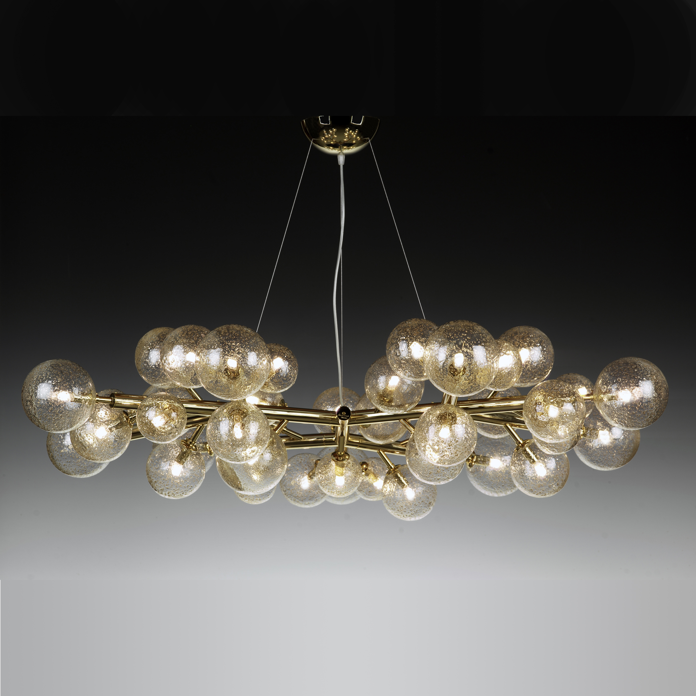 Mimosa 42 Brass Chandelier - This chandelier, designed and realised by the glassmaster Alberto Donà , is totally different from our classic collection. Its peculiarity is the simplicity of the frame decorated with 42 glass spheres – that during blowing are decorated by the master adding  gold, copper or brass powder. The result is a simple but impressive chandelier especially when lighted. Each sphere has a G9 2.5w bulb. Chandeliers are available in different sizes.