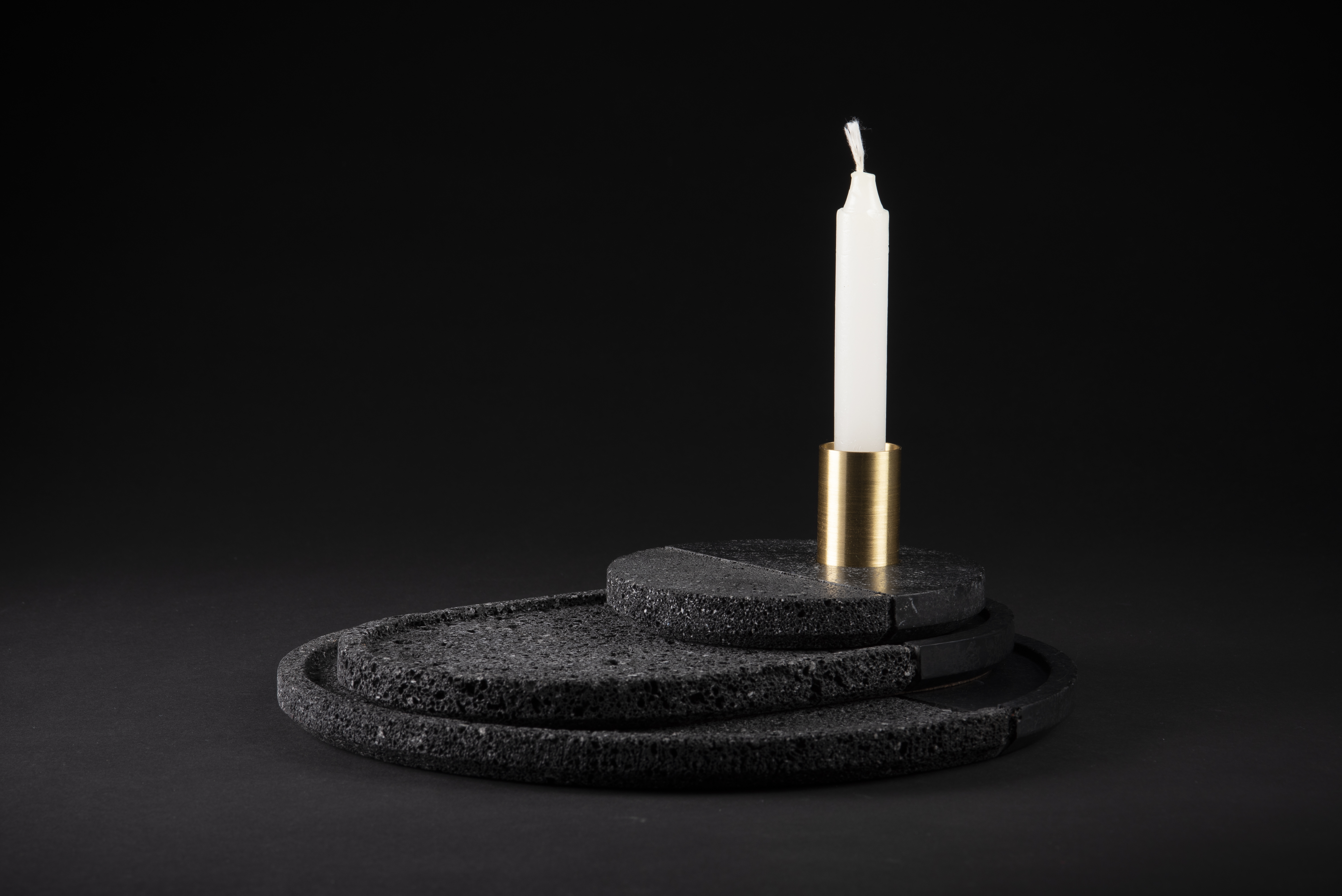 Lava Tray Set - <p>Volcanic rock is a witness to the power of nature: hand–polished by craftsmen with a millenary tradition, its unruly nature is transformed into a sensible and human object. With their dual texture, the collection of Lava plates is as much an homage to Mexican tradition as it is a glance in the direction of modernity. A brass accent completes the harmonious balance and reveals that Lava plates are as decorative as they are functional. Available in sets of 3 plates.</p>  | Matter of Stuff