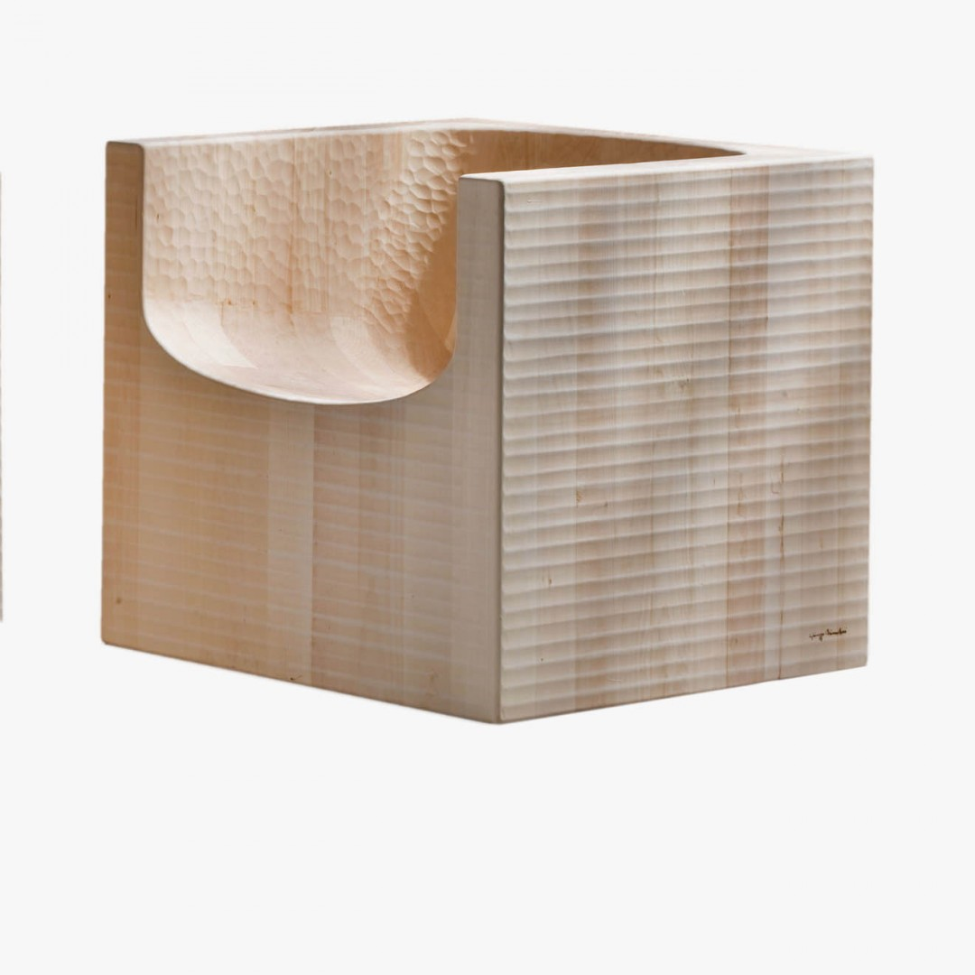 """ComacinaArmchair - <p>Comacina is an armchair made as a single block using wood with vertical grain. It is manually finished on all sides using a plane. The entire manufacturing and finishing process is carried out manually in our workshop. The wood used for this item is linden, typical of the European climate zone and used in traditional Latin sculpture. With a faint grain, linden is distinguished by a soft but extremely """"bonded"""" fibre: it, therefore, combines a certain lightness with great mechanical toughness. Its pale colour is highly valued and over time takes on a delicate pink hue.<br /> Customised and made with Italian walnut, European cherry, Slavonian oak, maple.</p>  