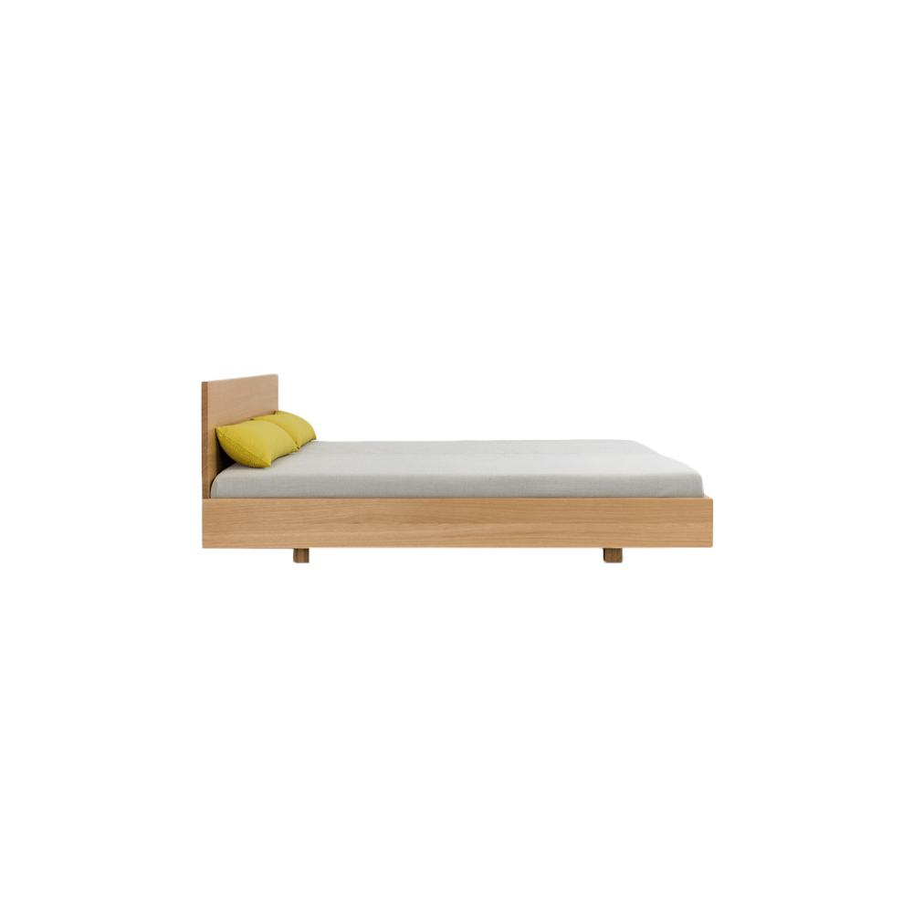 Simple HI Bed - The bed SIMPLE HI is available in two heights of headboard: in the heights 67 cm and 79 cm. The puristic design of SIMPLE foregrounds the living material. The lightness of the construction is intensified by the floating frame. SIMPLE – the bed in the simplest form and function. SIMPLE HI – with a tall solid wood bedhead.  The Simple HI bed is available in white oiled ash, oiled oak, oiled knotty oak, colour stained oak, oiled American cherry, oiled American walnut and oiled European walnut.  Available in special sizes(L190, 210, 220 cm) and comfort height 40 cm | bedside and feet each heightened 4 cm at an additional charge upon request. Slatted base system SILENT is not included.   The mattress size comes in L200 x W100,120 cm - Twin | L200 x W140 cm - Full | L200 x W160, 180 cm - Queen | L200 x W200 - King, California.   For colour stained oak options, please refer to the catalogue.       | Matter of Stuff