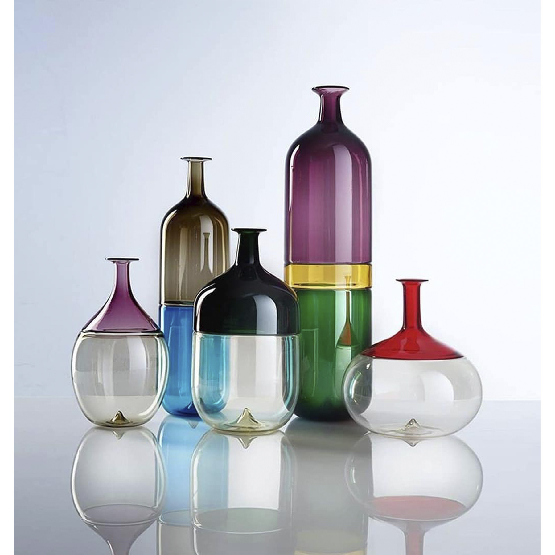 Bolle Tall Vase - Landscapes of glass and colour. Below and above. Before and after. Bolle ('Bubbles') transforms air into matter, in two distinct chromatic areas. One and two. Taupe and Adriatic Sea blue. Straw and red. Now and forever. A vase turns into a bottle for Tapio Wirkkala. Apple Green, Yellow and Purple. Three distinct spaces of colour that blend together thanks to the 'Incalmo' technique, a process by which two pieces of blown glass are melted together.  | Matter of Stuff