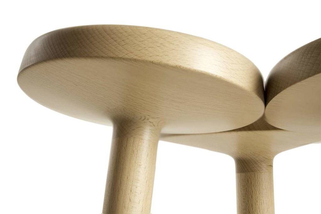 Temù Stool - A modular solid wood stool. Substantially, the idea behind this project is to create a stool using only the technique of wood turning. The structure consists of a single element (i.e., a circular head in which a cylindrical beech rod is inserted at the center). The combination of three of these parts generates a novel trefoil seating system that is surprisingly comfortable and effective. Temù is suitable for the kitchen snack bar or for cafe counters. | Matter of Stuff
