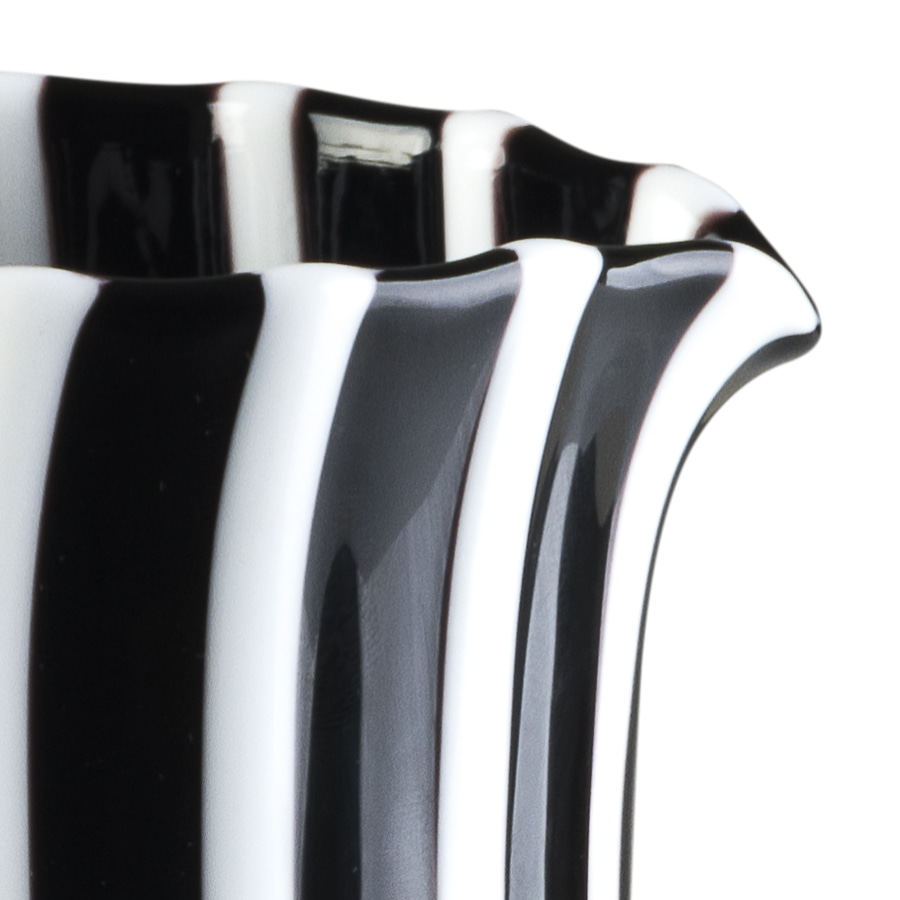Pastelli Jug - Pastelli is a collection comprising tumblers, jugs and centrepieces designed by LPWK for Purho. Created from blown glass and characterized by straight lines, minimal look and bold colours in their essence, the entire collection can easily fit different set ups, from the most essential - which uses a monochromatic and light coloured version - to the most kaleidoscopic ones.  Pastelli collection is available in two different basic colours — opal and transparent - matched with white in the following combinations:  White + Opal: blue / periwinkle / turquoise / orange / yellow lemon / green Nile / red / pearl grey  White + Transparent: amethyst / blue / yellow lemon / red / green lime /grey / green / aquamarine  Please refer to the colour chart in order to see the combinations.   Pastelli are available in personalised colours, please enquire for customisation. | Matter of Stuff