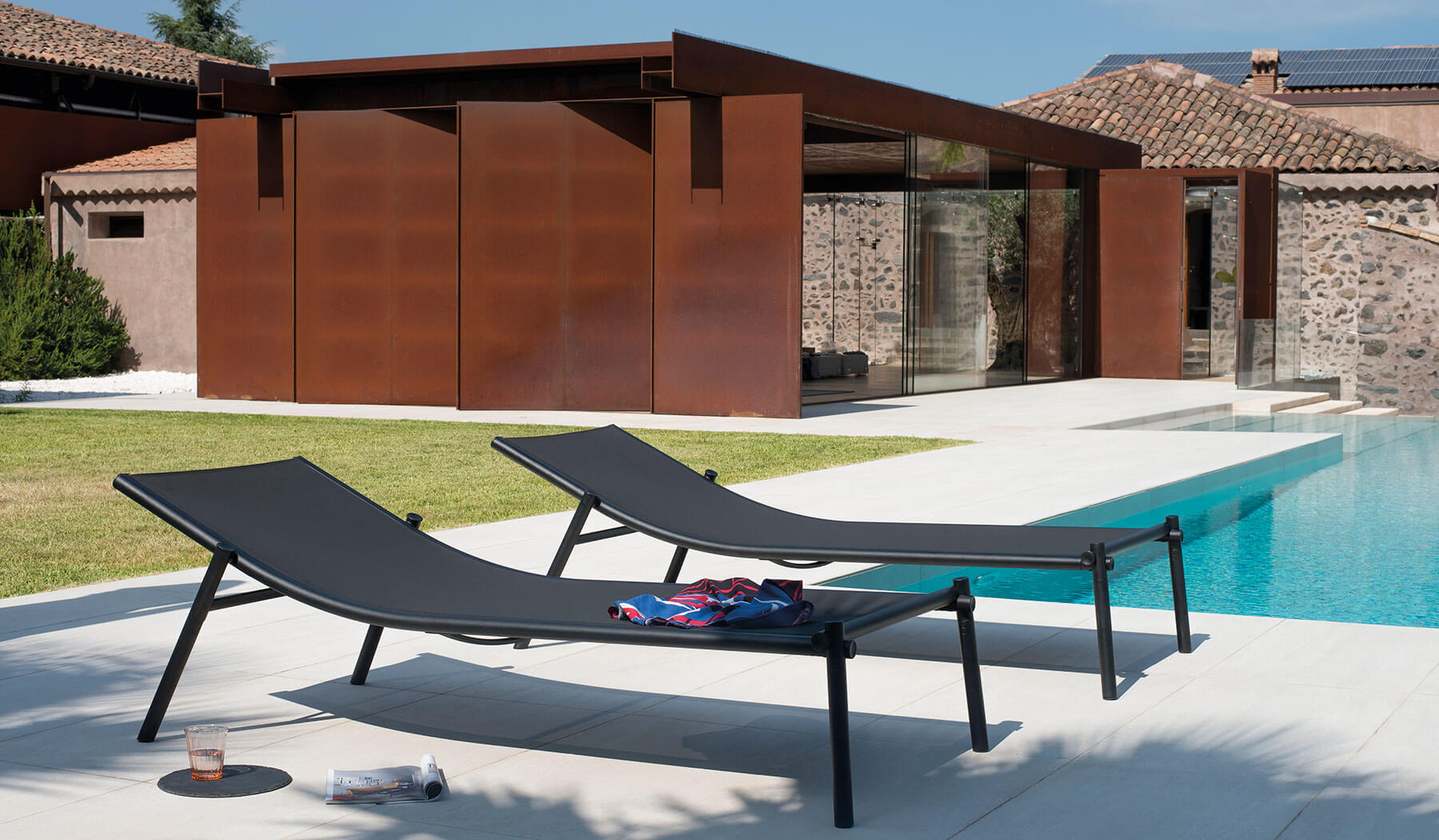 Terramare Stackable Sunbed - <p>Welcoming shapes and wide dimensions characterise the Terramare collection by Studio Chiaramonte-Marin, ideal for cosy and personal settings both indoors and outdoors. A complete range of furniture for both dining and living areas.</p> This sunbed is made from aluminium and has a sunbed cloth made from Emu-Tex. Emu-Tex is a fabric for outdoor use made with polyvinyl chloride thread. It has exceptional strength to ensure durability: maximum resistance to UV rays, the elements, humidity and sudden changes in temperature.  | Matter of Stuff