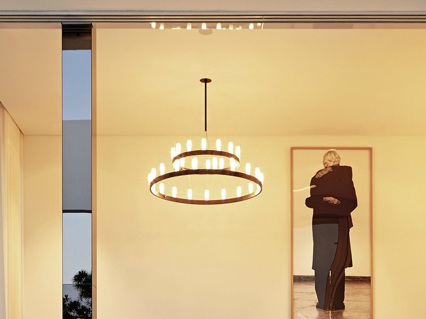 Chandelier Suspension Lamp Large - This spectacular lamp designed by David Chipperfield is inspired by those at the court of King Arthur. Available in two colors, in a single or double version with two concentric circles, it is a classy elegant lighting solution for any setting, even the most modern and minimal.New gold finishing, absence of tiges, 5 m length cables.  Suspension lamp with indirect light and dimmable double switch-on. Dual switching supplied to illuminate the two rings separately. Painted metal frame. Sandblasted borosilicate glass diffusers. Steel suspension cable. Transparent power cable. Painted metal ceiling rose. Bulb not included. | Matter of Stuff