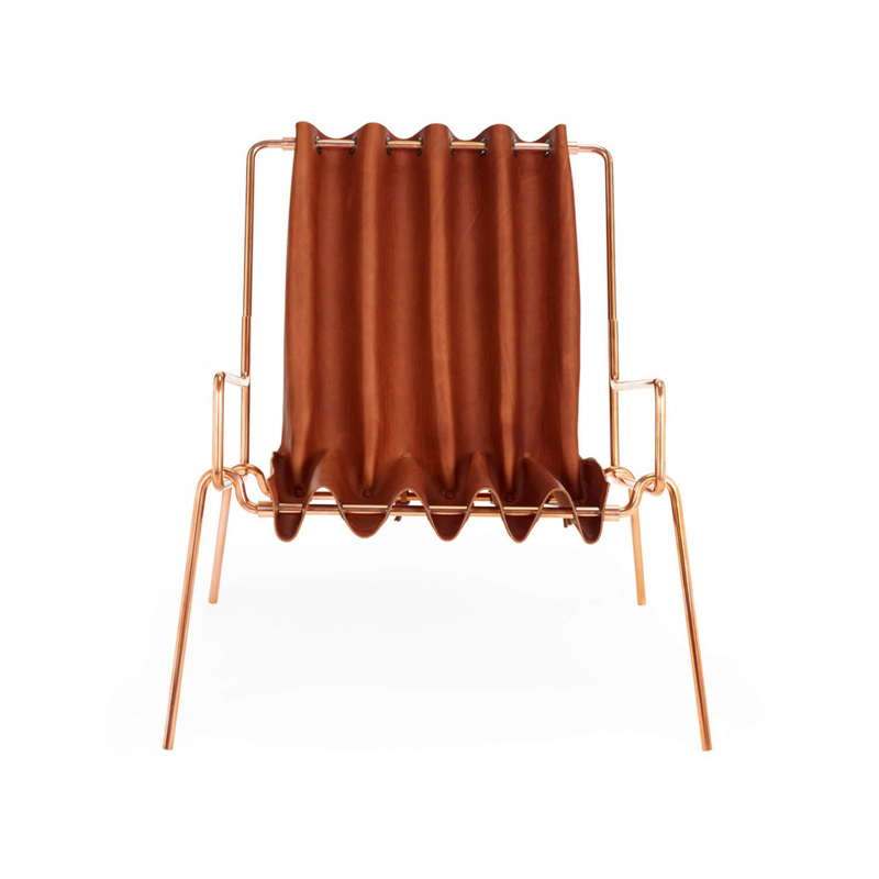Drape Lounge Chair - <p>Using the undulating forms of a curtain as it hangs from a pole, this lounge chair uses a mix of precision geometry and origami patterns to create a complex shape from a single piece of Tuscan vegetable tanned leather which was handmade in England.<br />