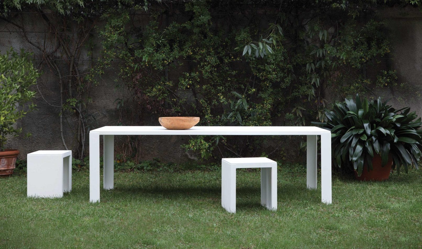 Big Irony Outdoor Table - The Big Irony Outdoor Table sits well among the other BIG IRONY products to give your garden an industrial yet sophisticated feel, however, it also looks perfect alone. It can be placed in the home as well as the garden. It has a demountable frame and top, legs 100 x 100 mm in bent sheet steel. Treated for outdoor use and polyester epoxy painted, rust colour, white or gunmetal colour.  >Products of Outdoor Collection are designed to be used outdoor. If left directly in contact with atmospherical agents without any protection all the time, they will change – as it is happens to all outdoor products. During winter we suggest to tilt the table legs in order to have water flowing and not becoming stagnant.</p>  | Matter of Stuff