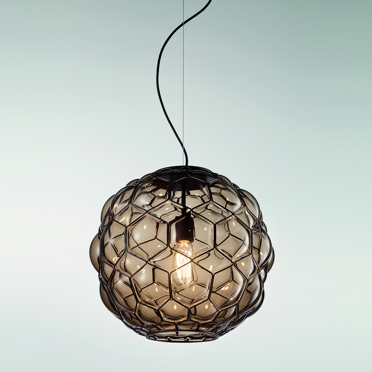Galapagos Pendant Light - The Galapagos Pendant Light is designed in a way that resembles the shell of a tortoise. It almost looks alive and moving due to its organic shape. This light comes in two finishes : Smooth Taupe and Acidated Milk White and the interior is Satin Amber. It is hand made blown glass suspension with the techniques of the old Murano glass masters. Uses 250V input, 1X E27 max 100W ~ IP20 Bulbs</p>