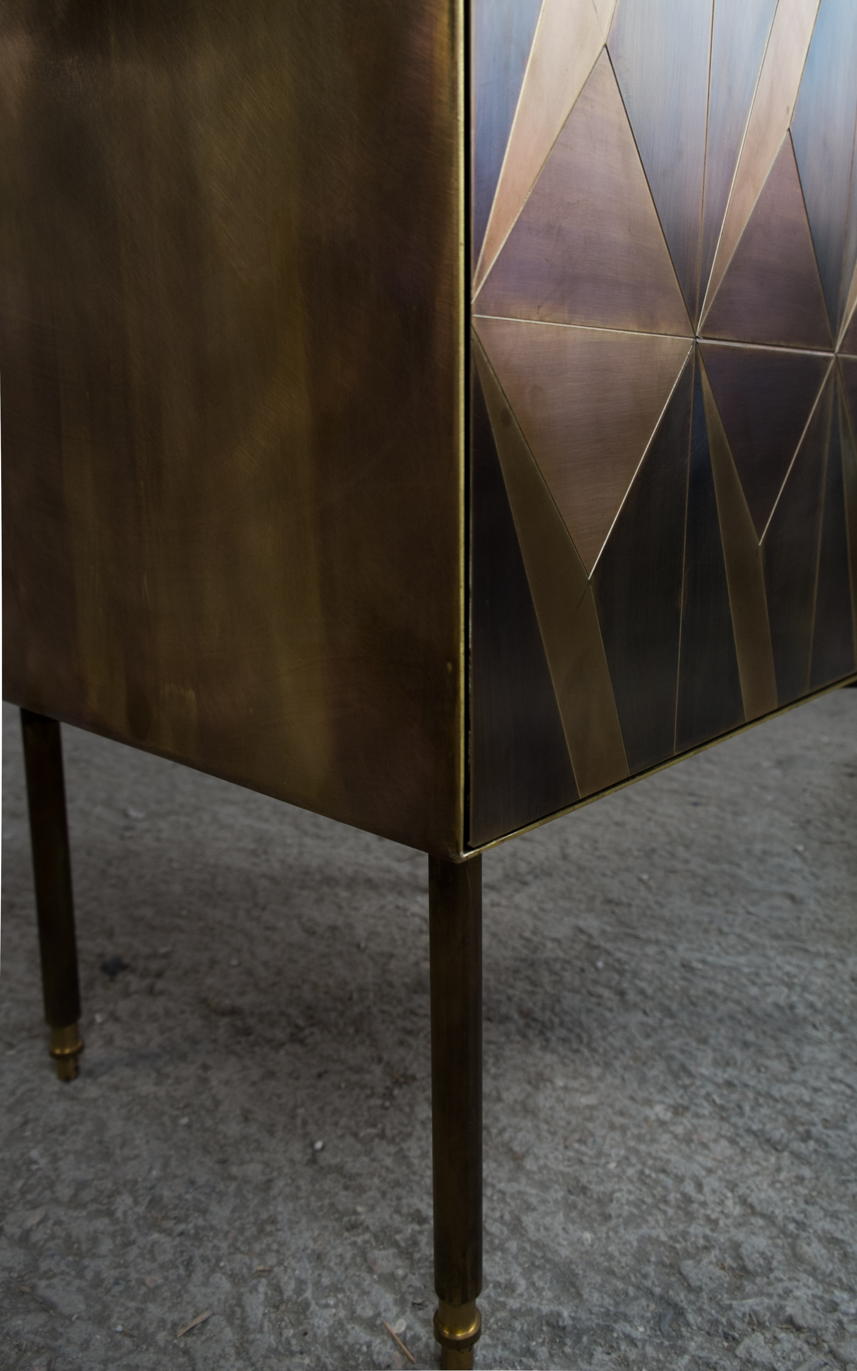 Marque' Dry Bar Cabinet - <p>The collection by Alessandro Zambelli comprises a series of storage furniture that include a small cabinet, a dry bar, a console and a coffee table, where the metal inlays remind of those traditionally found in Art Deco wooden furniture, adding a new element of character and prestige. The linear essentiality of the forms, which is reflected in each element of the collection, is enriched by the presence of precious superficial decors that are juxtaposed through inlays: small metal oxidised plates animate the surface of each storage element with their refined alternation of delicate geometrical motifs. The oxidation process brings a unique mutation of the surface itself, enriched by a whole variety of shades and gradation.<br />