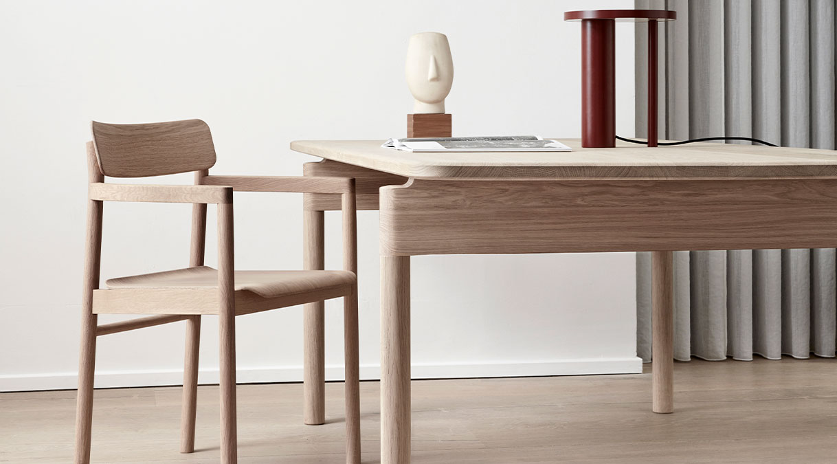 Post 6442 Dining Table - With its long rectangular table top and sturdy cylindrical legs, the Post Table is the perfect merging of functionality, simplicity and serenity in a classic design expressed with modern minimalism. The structural frame is exceptionally crafted in solid wood, teamed with a table top in solid oak. Enjoy loads of leg room in the wide space between the legs on either end, adding to the appeal of this practical, tactile table for dining or meeting in a residential, corporate or hospitality setting.  The Post Collection is an example of eliminating anything extra in order to solely focus on the essential. For designer Cecilie Manz, creating is about examining the purpose of a piece of furniture. Stripping the concept down to only what's necessary, the form emerges from the function in an expression that's pure and purposeful.  It's this simplicity imbued with a sense of beauty that is at the core of the new Post Collection from Manz. The name is a nod to the former home of the Royal Mail, renovated into our flagship showroom in Copenhagen Clean, uncluttered lines are the signature traits of the Post Table and Post Chair, each boasting a solid wood frame that reflects our heritage of wood craftsmanship and appreciation for authentic materials.  The Post Chair is upright and unassuming, with clean, classic lines. The plywood seat and back are light yet sturdy, while the arms offer just enough support with a minimal use of space. Add to that the option of an upholstered seat in leather or fabric, and you have a subtle design that could easily fit into a residential setting, restaurant, café or corporate environment.   The perfect partner is the Post Table, featuring a long rectangular table top and matching cylindrical legs. The solid wood frame provides a stable structure for the streamlined table top available in solid oak. Given the placement of the legs on either end, the result is loads of leg room. An extra advantage to the appeal of this prac