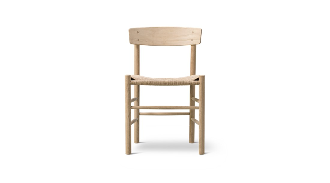 Mogensen J39 Chair - Designed by Børge Mogensen in 1947. J39 is a versatile masterpiece crafted from solid wood, featuring a hand-woven seat in natural paper cord. | Matter of Stuff