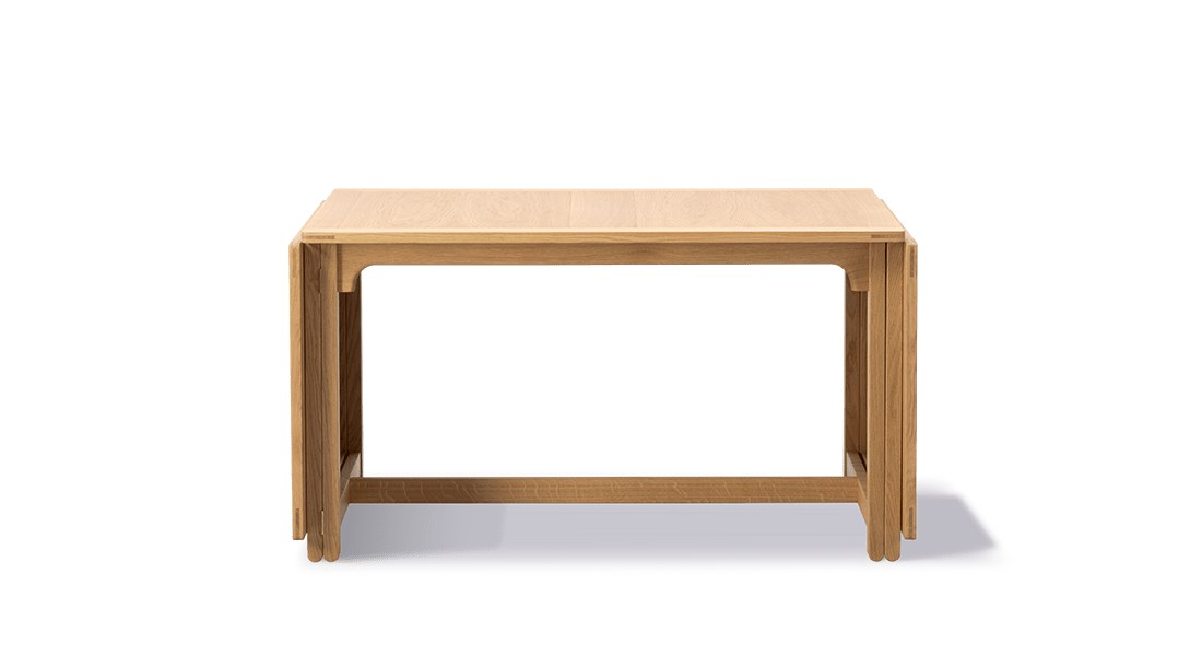 BM 71 Library Table - The Library Table is modest yet confident and refined in its visual expression. Pure in terms of lines and construction, it reflects Mogensen's meticulous, ultra functional approach to design, where every detail has a precise purpose that correlates to its use.  Practical, durable designs to enrich people's everyday lives. That sums up the essence of Børge Mogensen's overall intention with his work. Referring to wood as his preferred material, Mogensen designed an array of pieces noted for their sober expression and superb sense of proportion.   Mogensen applied the same principles to his iconic series of tables, appreciated for their clean, uncluttered lines inspired by the functional, utilitarian approach of the Shaker movement.   All our Mogensen tables reflect his ambition to create beautiful, distinctive furniture by emphasising simple horizontal and vertical lines and surfaces. A restrained aesthetic with a modest appearance intended to create a sense of tranquillity.   All of which makes the Mogensen tables an ideal choice for any gathering you can imagine. From corporate settings and meeting rooms to group dining and socialising.   Matter of Stuff