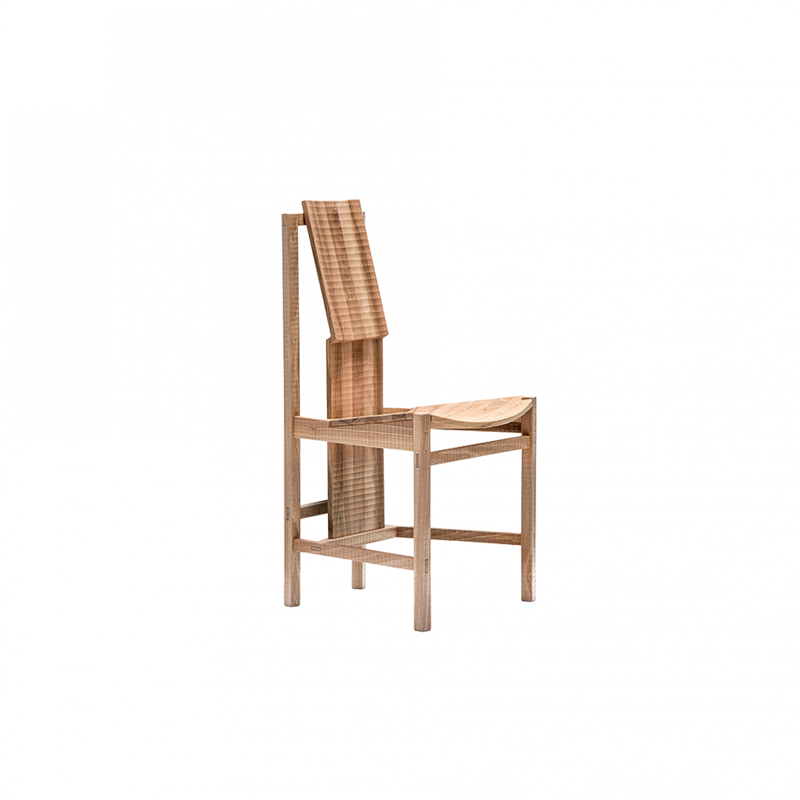 "Pisana Chair - Pisana is a chair with solid wood structure assembled by interlocking. Finished on all sides by plane and gouge. The entire manufacturing and finishing process is carried out manually in our workshop. The wood used for this piece is Juglans Regia – common Italian walnut; not dried but ""raw"". This wood belongs to the Latin tradition of furniture-making and features an extremely compact fibre which can, however, be worked without too much difficulty; it is therefore highly suitable for household items. Over time the wood hardens and becomes extremely resistant, and oxidises slightly to take on a progressively warmer amber colour. Customised and made with European cherry, Slavonian oak, maple.