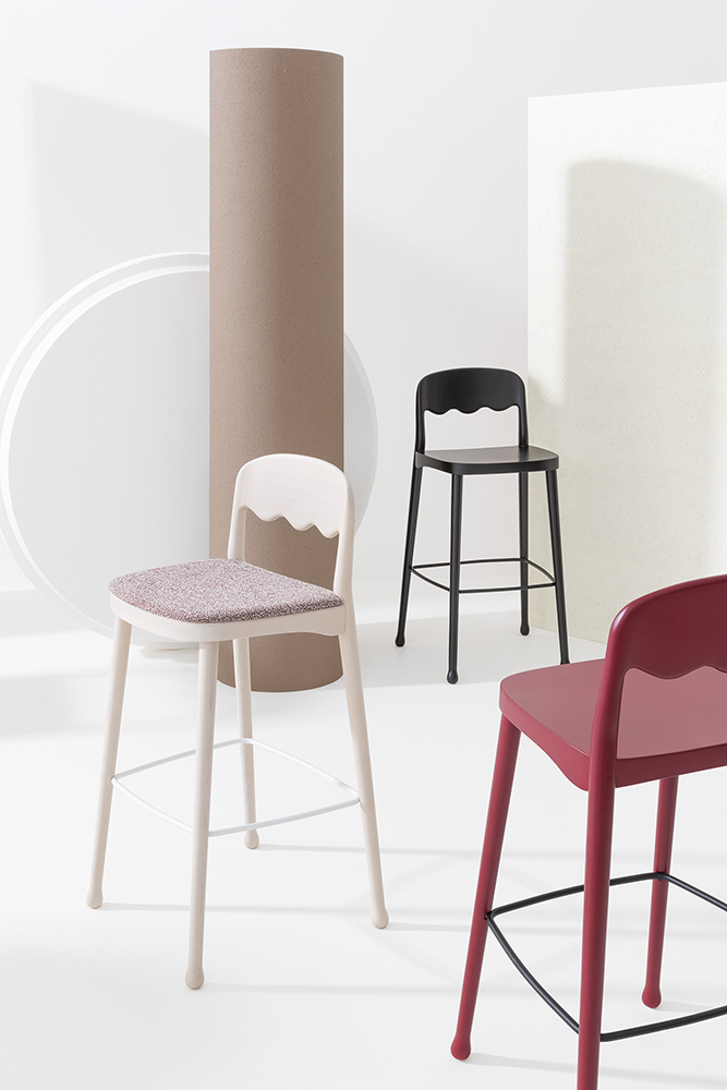 Frisee Upholstered Barstool - The Frisee Barstool is perfect for breakfast bars or indoor bars and would look aesthetically pleasing in a group for example in a two or a four. This Barstool has an upholstered seat which can be fabric, leather or you can choose your own material. The frame comes in either Ash or Beech and can be lacquered.  The wavy design of the back rest is unique yet simple, it keeps its ergonomic form while adding personality to the barstool. Please enquire for more information and finishes. | Matter of Stuff
