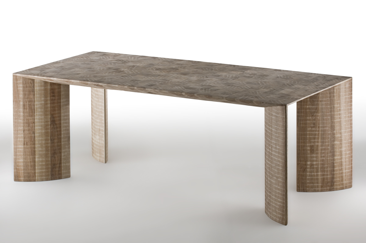 """Arcangelo Dining Table - <p>Arcangelo is a table made as a single block using wood with vertical grain. It is manually finished on all sides using a gouge. The entire manufacturing and finishing process is carried out manually in our workshop.<br /> The wood used for this piece is Juglans Regia – common Italian walnut; not dried but """"raw"""". This wood belongs to the Latin tradition of furniture-making and features an extremely compact fibre which can, however, be worked without too much difficulty; it is therefore highly suitable for household items. Over time the wood hardens and becomes extremely resistant, and oxidises slightly to take on a progressively warmer amber colour.<br /> The Arcangelo table is an utterly pure image; its power and elegance make it a central element in a future domestic habitat.</p>  