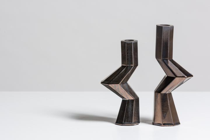 Fortress Militia Candlesticks Bronze - <p>Designer Lara Bohinc explores the marriage of ancient and futuristic form in the new Fortress Vase range, which has created a more complex geometric and modern structure from the original inspiration of the octagonal towers at the Diocletian Palace in Croatia. The resulting hexagonal blocks interlock and embrace to allow the play of light and shade on the many surfaces and angles. These are handmade from ceramic in a small Italian artisanal workshop and come in different finishes</p>