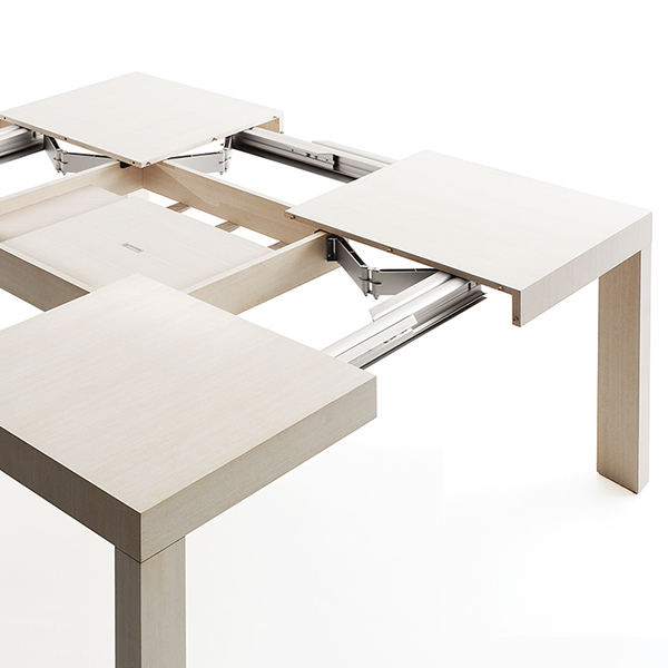 Quartetto Extendable Square Table - Squared table extensible in both directions with aluminium rails. Characterised by great elegance and harmony, real protagonist of the most different environments of the contemporary living, it guarantees an almost total flexibility, adapting itself to every context. Perfect for an office too, it is also suitable as executive desk or splendid meeting table, extremely flexible and adaptable for every need.    Matter of Stuff