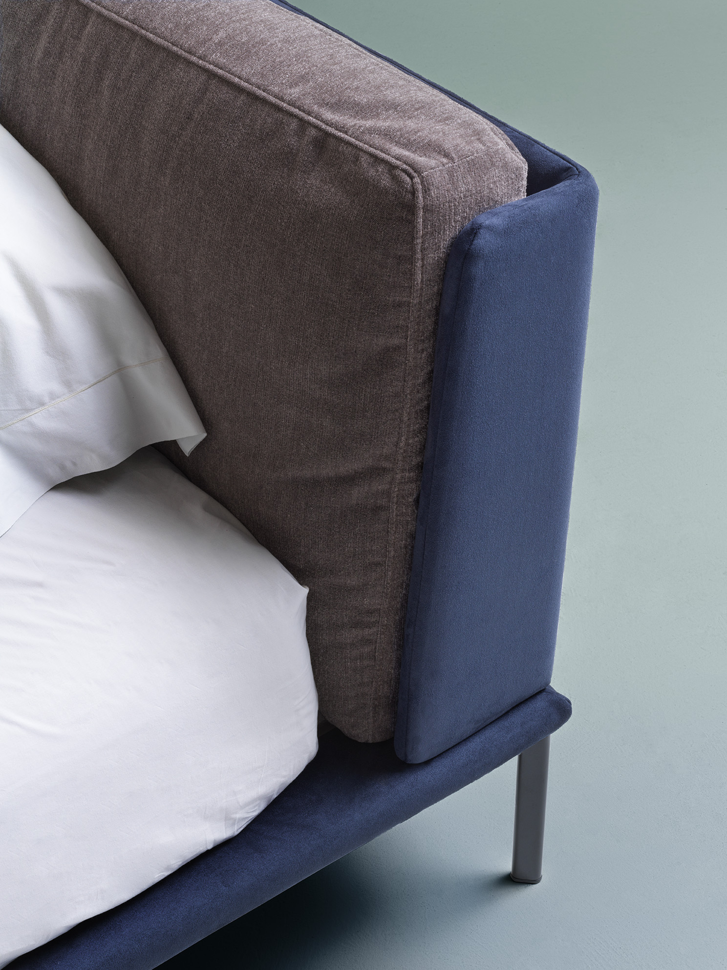 Mise Bed - <p>The primary shapes express intrinsic softness. The basic, welcoming and simple design stands the test of time.  A play of shapes and volumes come together: Mise is softness and linearity.</p> <p>A bed with removable fabric cover and Beechwood bed slats with legs in painted steel. It has a wooden headboard and the bed edges are covered with polyurethane foam and polyester fiber lining. The headboard cushions have sterilized feathers with an insert of non-deformable polyurethane foam. </p> <p>Prices vary depending on the dimensions and fabrics chosen. Mattress is not included in the price. Please enquire for full details.</p>  | Matter of Stuff