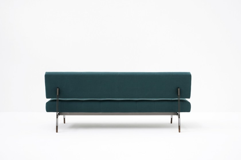 Oliver Bench With Back - A re-edition of the legendary Model 872, designed by Gianfranco Frattini in 1957, the Oliver sofa embodies the inseparable fusion of form and material in the renowned Italian designer's aesthetic concept. The visual lightness of the solid structure in powder-coated or chrome steel artfully balances the sophisticated artisan craftsmanship in the hand-tufted seat and backrest, upholstered in leather or fabric. The wood feet, crafted in stained ash, emphasize the constructive and aesthetic attention to detail characteristic of Frattini's work. An iconic example of contemporary Italian design, Oliver blends the simplicity of uncluttered elegance and unpretentious comfort, flawlessly constructed. | Matter of Stuff