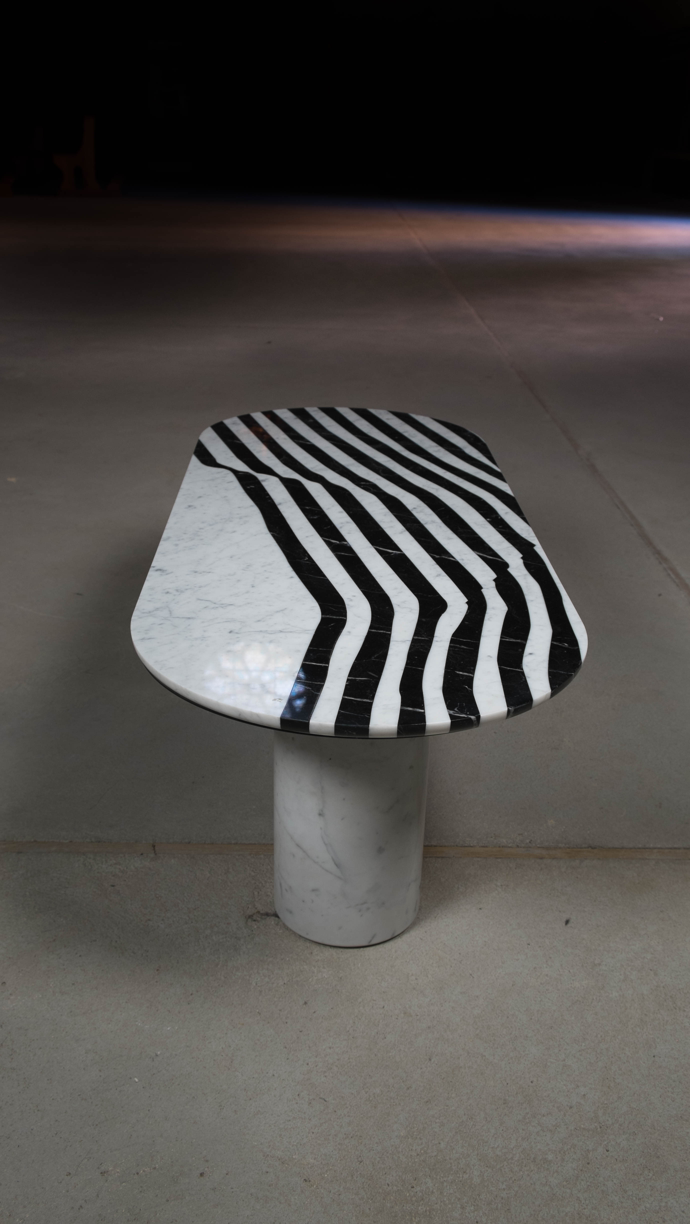 The Veiled Oval Side Table - <p>The Veiled is a collection of tables and trays made of marble with a graphical pattern inspired by an ancient statue.<br />
