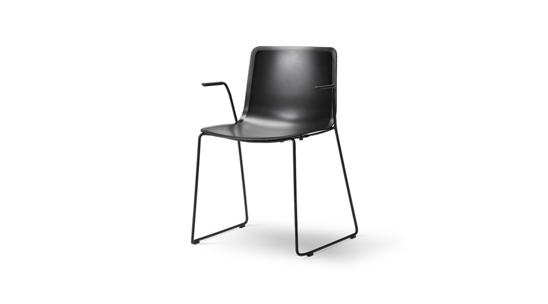 Pato Sledge Base Armchair - Pato is a carefully crafted multipurpose chair in eco-friendly polypropylene that can be used outdoors. The chair is available with a range of optional features including coupling. The chair can be tuned from basic to exclusive with optional upholstery.  Pato is a prime example of our focus on sustainability and protecting the environment, reflected in a chair that's 100% renewable and recyclable. All components can be incorporated into future furniture production, thus contributing to a circular economy by minimising the use of materials, resources, waste and pollution.   Merging traditional production methods with cutting-edge technology, Pato is a human-centric, highly versatile series of multi-purpose functional furniture that draws on our in-depth experience with materials, immaculate detailing and heritage of fine craftsmanship. Allowing us to apply our high standards of texture, finish and carpentry techniques to an array of materials in addition to wood for products aimed at a mass market.   With its clean lines and curves, Pato echoes the ethos of Danish-Icelandic design duo Welling/Ludvik. Demonstrating their belief that good design has the ability to be interesting, even when reduced to its most simple form. Where anything extraneous is eliminated and every detail has a purpose.   Together we spent nearly three years developing the shell structure to have a soft surface that's also wear and tear resistant. Enhancing the chair's ability to optimally conform to the user's body is a subtle beveled edge. A technique from classic cabinetmaking, which gives the chair a sense of handcrafted finesse. Each Pato is detailed and finished by hand by our highly skilled crafts people, who refine the beveled edge and the silky, resilient surface. Setting a new standard for the execution and finish of polypropylene.   Since the success of its initial launch, we've expanded Pato into an extensive collection of variants, featuring armchairs, bar
