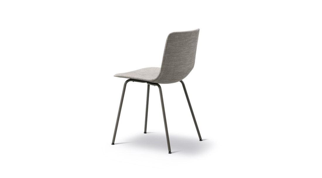 Pato 4 Leg Tube Base Center Chair Fully Upholstered - Pato is a carefully crafted multipurpose chair in eco-friendly polypropylene that can be used outdoors. The chair is available with a range of optional features including coupling. The chair can be tuned from basic to exclusive with optional upholstery.  Pato is a prime example of our focus on sustainability and protecting the environment, reflected in a chair that's 100% renewable and recyclable. All components can be incorporated into future furniture production, thus contributing to a circular economy by minimising the use of materials, resources, waste and pollution.   Merging traditional production methods with cutting-edge technology, Pato is a human-centric, highly versatile series of multi-purpose functional furniture that draws on our in-depth experience with materials, immaculate detailing and heritage of fine craftsmanship. Allowing us to apply our high standards of texture, finish and carpentry techniques to an array of materials in addition to wood for products aimed at a mass market.   With its clean lines and curves, Pato echoes the ethos of Danish-Icelandic design duo Welling/Ludvik. Demonstrating their belief that good design has the ability to be interesting, even when reduced to its most simple form. Where anything extraneous is eliminated and every detail has a purpose.   Together we spent nearly three years developing the shell structure to have a soft surface that's also wear and tear resistant. Enhancing the chair's ability to optimally conform to the user's body is a subtle beveled edge. A technique from classic cabinetmaking, which gives the chair a sense of handcrafted finesse. Each Pato is detailed and finished by hand by our highly skilled crafts people, who refine the beveled edge and the silky, resilient surface. Setting a new standard for the execution and finish of polypropylene.   Since the success of its initial launch, we've expanded Pato into an extensive collection of variants