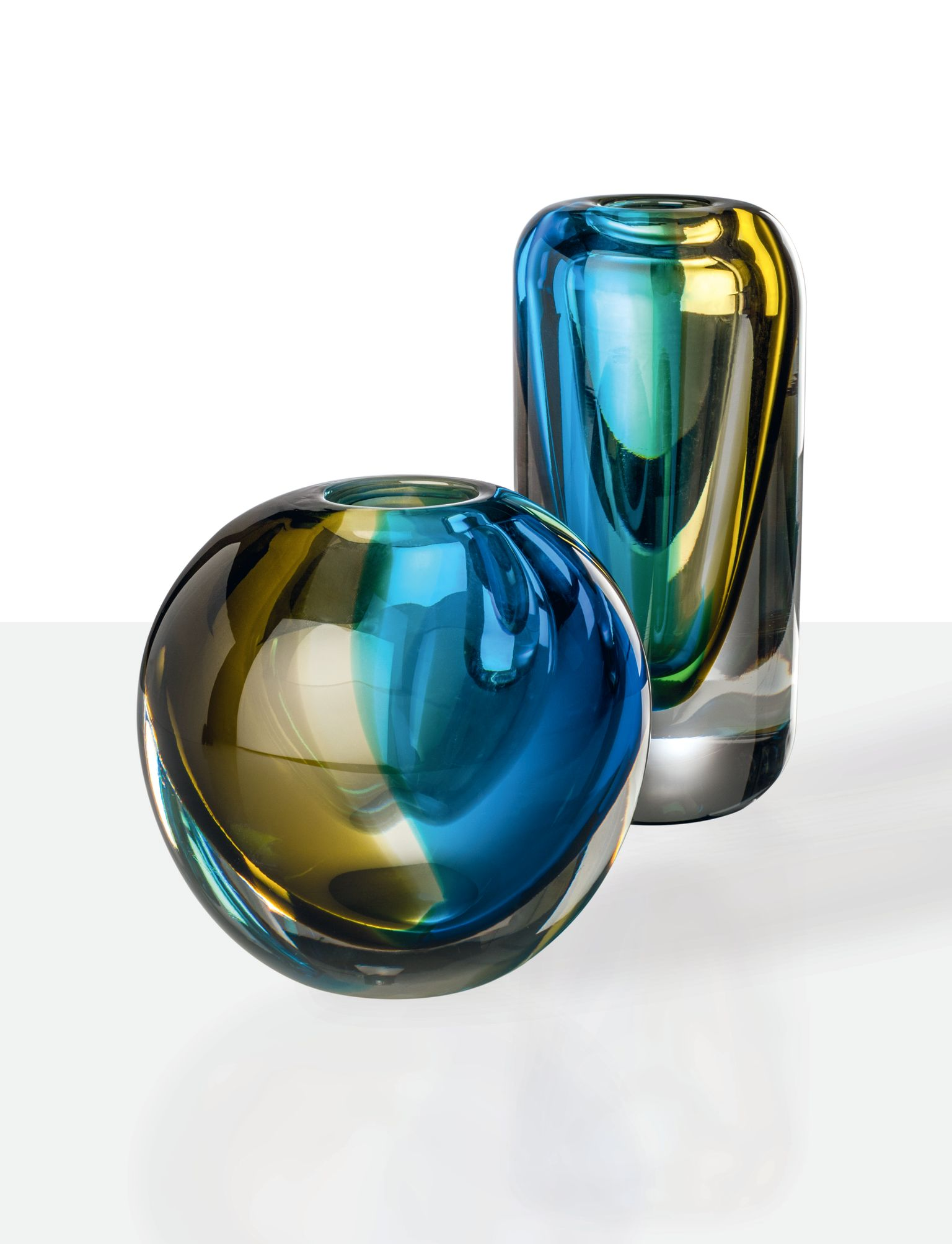 """Venezia Vase - Transparent Crystal meets Aquamarine and Bamboo. Its tones speak of the Venetian lagoon and its marshy origins: fragments of Venice on glass. A celebration made all the more special by the use of the """"Sommerso"""" technique on blown glass. 