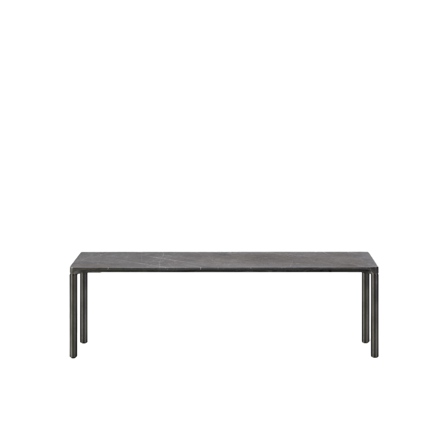Piloti 6745 Stone Coffee Table - With its simple, unadorned silhouette and slender profile, Piloti in stone exudes a unique kind of elegance. The extra appeal is all about the subtle detailing of the table top´s edge ensuring a seamless transition to the legs which merge into a balanced entity. The impression is a single line floating on four delicate legs. The Piloti in Stone tables all have the same height, which makes them ideal to place individually or together in a space to create a sense of continuity.  Adding to Piloti's tangible materiality is our Piloti Stone variant, featuring a stone table top supported by steel legs. Each table top is one-of-a-kind, with its own subtle differences in surface patterns and tonalities. We've applied our expertise in craftsmanship to create a unique profile never seen before in this type of stone table. The sleek marble top transitions gracefully with the sturdy cylindrical legs. The result is a seamless visual impression that makes Piloti in Stone an ideal statement piece, whether for private homes, hotels or executive settings. | Matter of Stuff