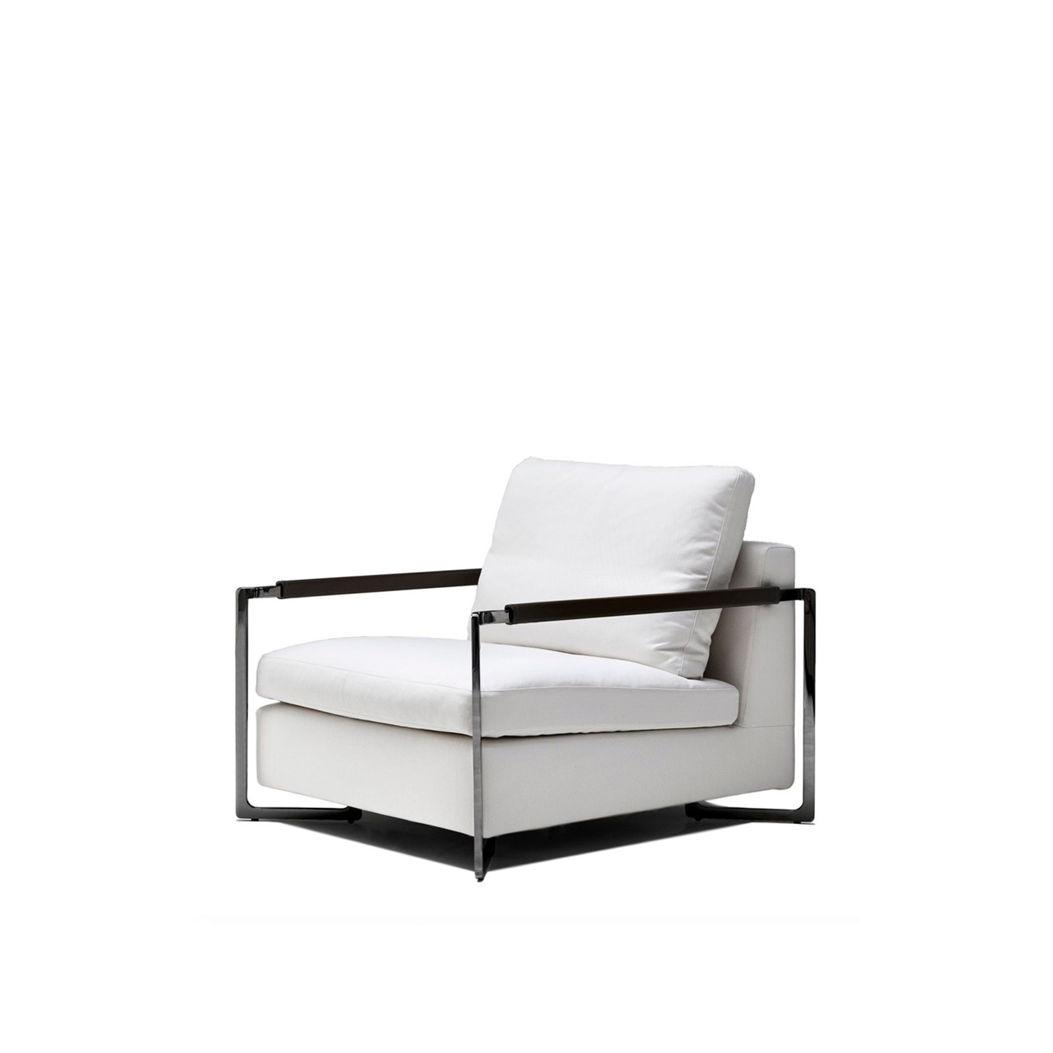 No Logo Light Lounge Chiar - No logo light features a dual soul, both masculine and feminine, which enables this collection of two- and three- seater sofas and a comfortable armchair to fit equally seamlessly into the cosiest of family homes and into the most rigorous of public spaces. Its most striking features are the austerity of the steel frame and the unexpectedly comfortable seat cushion. In production since 2005, No logo light places itself squarely at the centre of everyday life, always drawing attention to itself, yet with the utmost discretion. Fully removable covers.  Additional removable cover is available, please enquire for prices.  Materials: Structure in wood padded with variable-density polyurethane foam and covered with velfodera on a polyester fiber. The seat is sprung with elastic straps reinforced with polypropylene. Feet in shaped metal in black nickel finished. Armrest is covered with leather profile. Seat cushion is in washed and sterilized goose down divide into compartments, covered with 100% white cotton fabric and with a polyurethane foam core. Back cushion is in washed and sterilized goose down divided into compartments and covered with 100% cotton fabric anti-feather. | Matter of Stuff