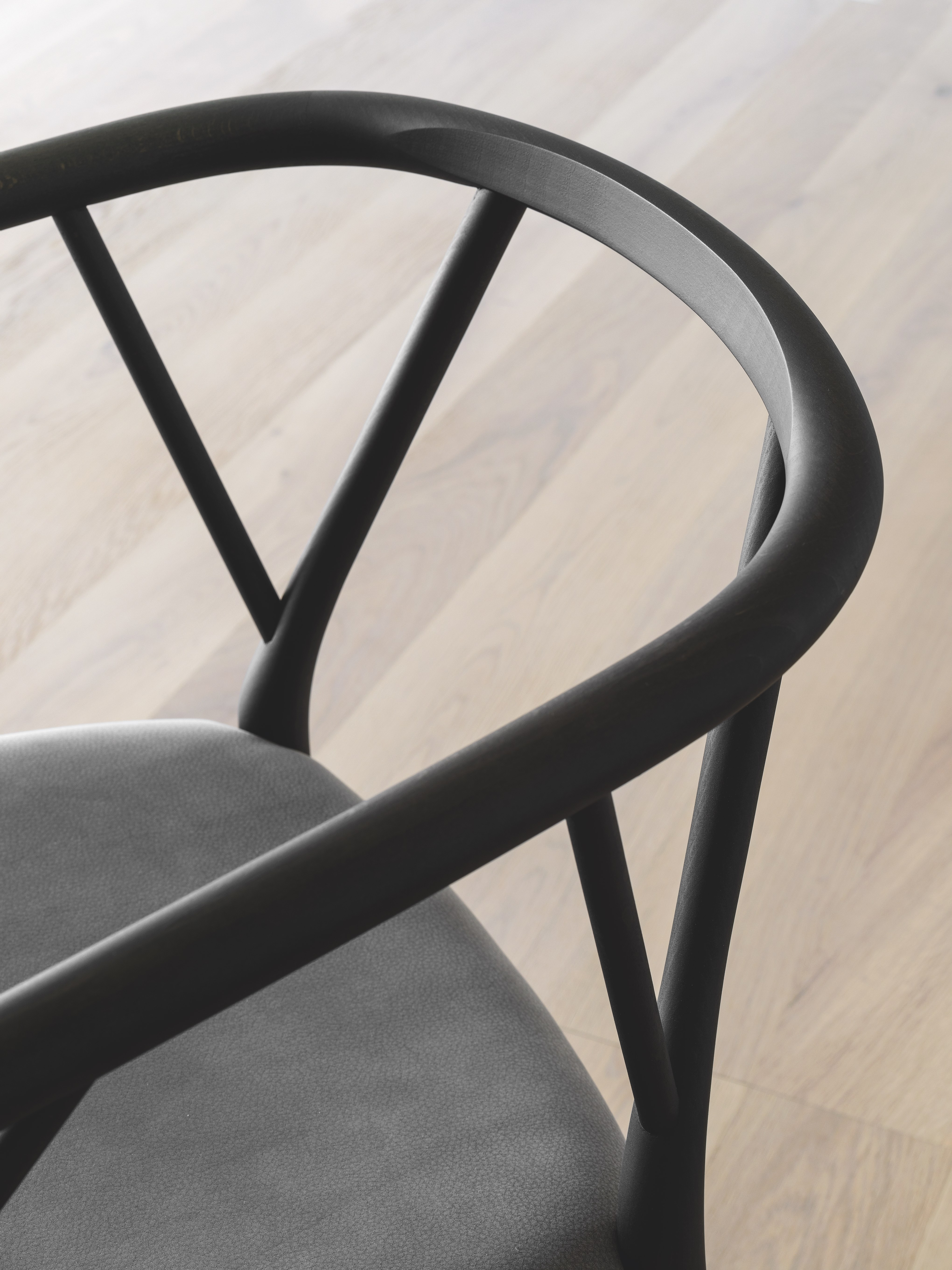 Valerie Chair - The chair is made in bended wood. It represents the essence of the sitting archetype, due to the used materials and to the form. Doesn't want to impress, just to perform in the better way the primary function: to accommodate. The chair develops the contrast between the essential structure and the wooden seat: the first devoted to the support and the second, to the comfort. The chair has a solid wood structure, available in the listed wooden finishes, stained aniline or lacquered. Structure available with or without seat-cushion, upholstered in the listed fabrics.  More options of fabric available, please enquire.   Matter of Stuff