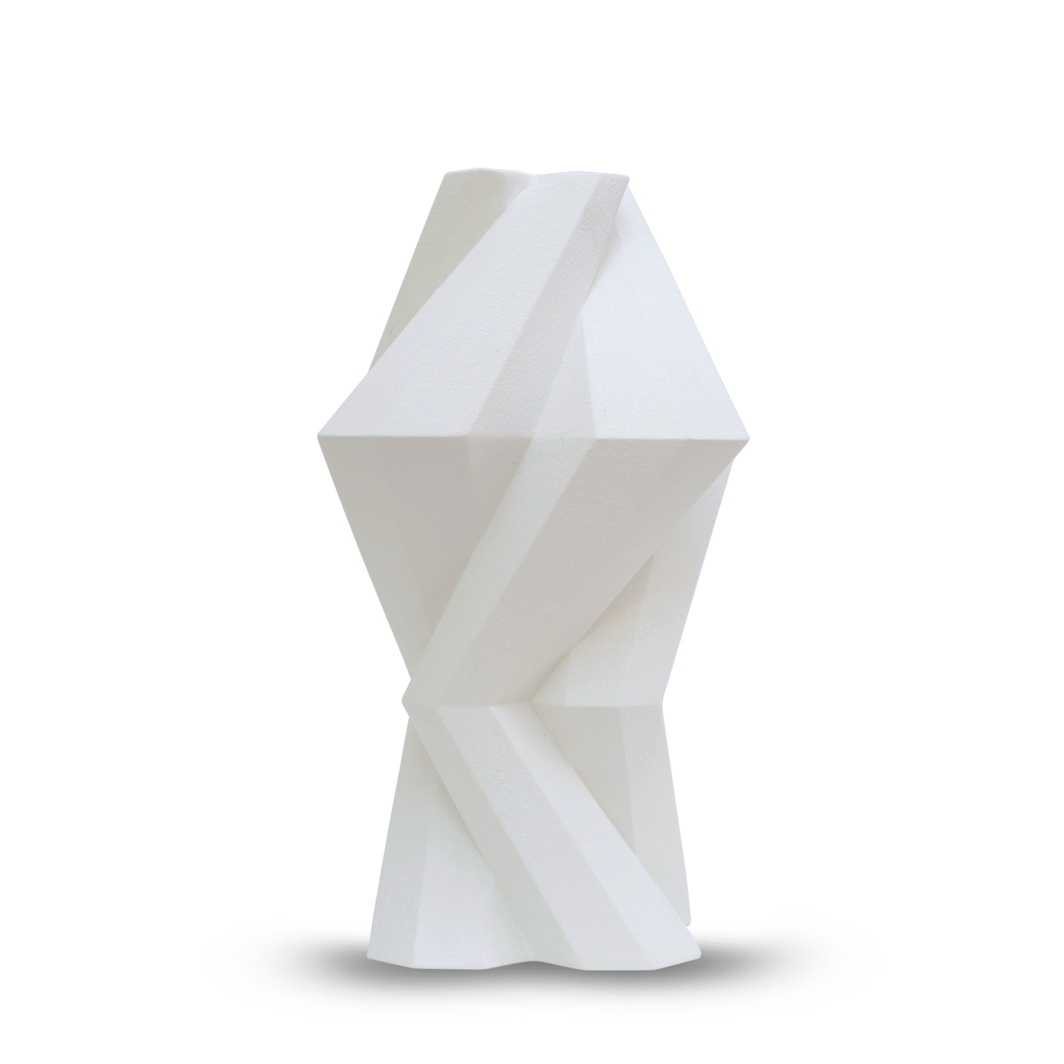 Fortress Column Vase Crackled White - <p>Designer Lara Bohinc explores the marriage of ancient and futuristic form in the new Fortress Vase range, which has created a more complex geometric and modern structure from the original inspiration of the octagonal towers at the Diocletian Palace in Croatia. The resulting hexagonal blocks interlock and embrace to allow the play of light and shade on the many surfaces and angles. There are four Fortress shapes: the larger Column and Castle (45cm height), the Pillar (30cm height) and the Tower vase (37cm height). These are hand made from ceramic in a small Italian artisanal workshop and come in three finishes: dark gold, bronze and speckled white.</p>    Matter of Stuff