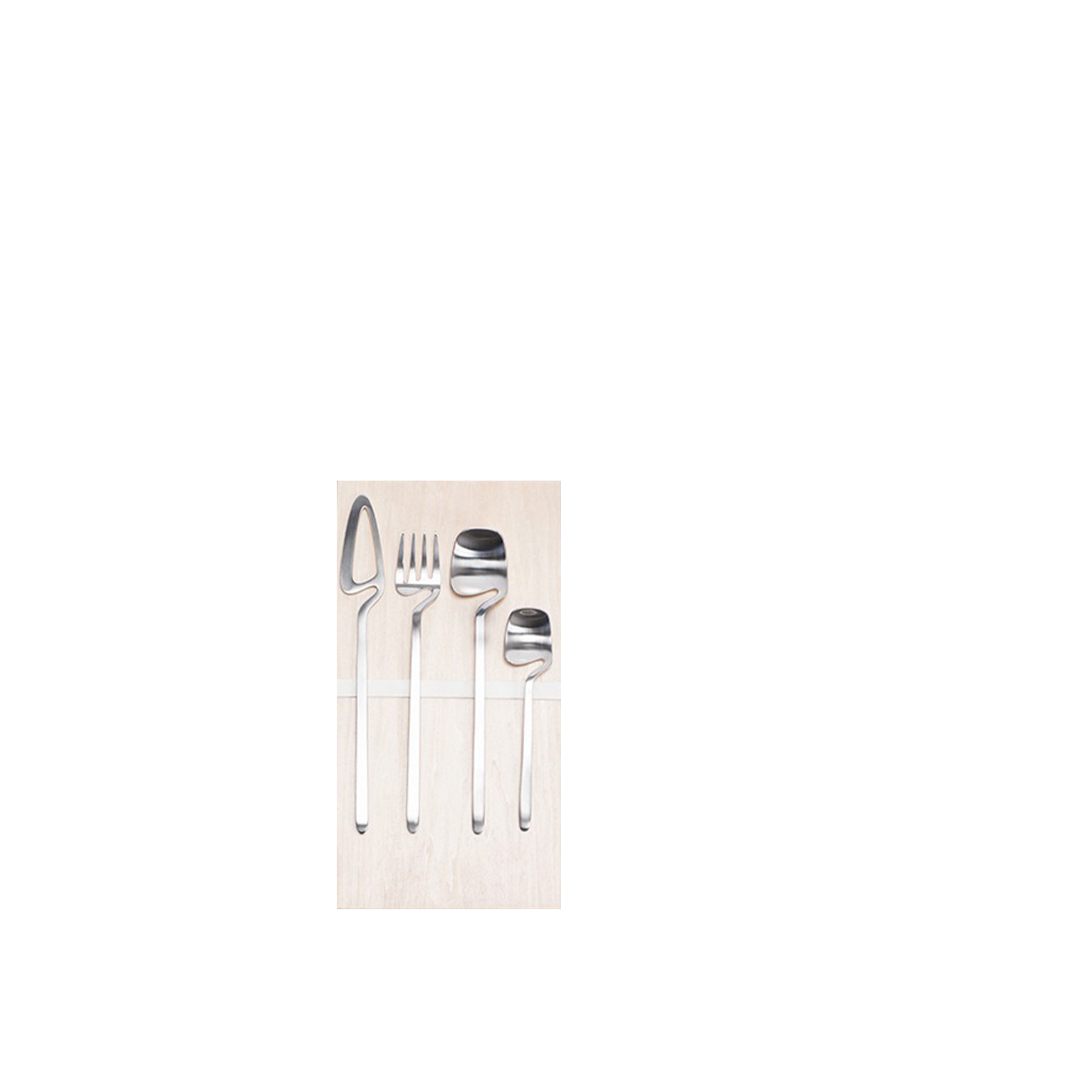 """Nendo Cutlery Giftbox 16 pcs - The cutlery """"skeleton"""" has been reduced to the absolute minimum, limiting the amount of material used whilst still retaining its functionality, left remaining is the outline of the cutlery like the image of a skeleton reflected in an X-ray.  It can be hooked and stored in various places in the kitchen and the teaspoon can be hooked onto the rim of the cup. There are four items, a spoon, fork, knife, and teaspoon, the set also has a dedicated stand and wall hook to display the set. The cutlery is 18/10 stainless steel, also available with a black PVD coating. Each wooden giftbox is complemented by 4 soft cotton bags.  All colours are dishwasher proof and suited for horeca use. 