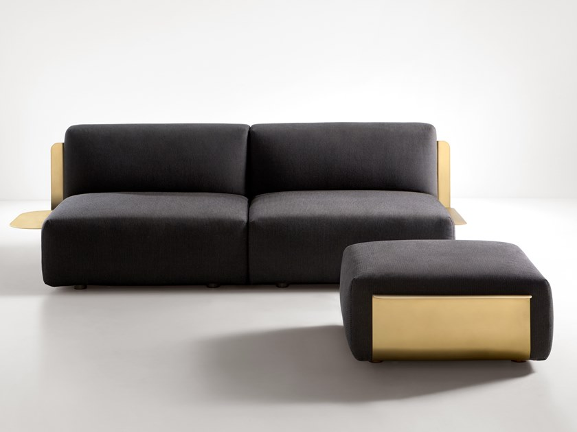 Loom Sofa - The Loom collection challenges the apparent contradiction between the hardness of metal and the soft comfort of upholstery. Loom turns an oxymoron into inspiration, positioning a welcoming, familiar form atop a brass clip that embraces as it holds the cushions in place, defining its very shape. Loom embodies the De Castelli approach to the world of upholstery: while respecting the comfort of the ample seat, metal remains the star, truly shining in its role as supporting arms that gently rise up at the sides.  Upholstered sofa available in two colours, with metal back and armrests, wooden monocoque and polyurethane foam seat cushions (D35 elastic density). The outer fabric can be entirely removed thanks to Velcro fastenings. Dry clean only. Black PVC feet. | Matter of Stuff