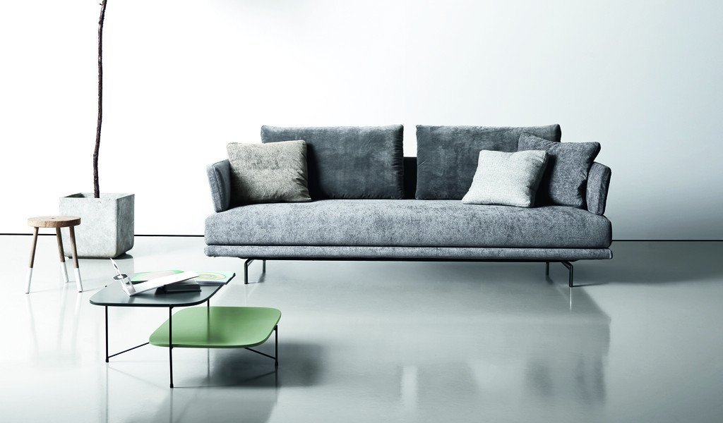 Quinta Strada Two Seater Sofa - Launched in 1996, the Quinta Strada seating range represented a pioneering design in modern style.‎ Streamlined yet modularly flexible, the range has since then been restyled and re-produced with a sensitivity that is mindful of the new contemporary language.‎ The black chrome finish of the feet, the thinner joining clamps as well as the lightness of the base and back support are elegant touches aligned with modern lifestyle.‎ The various elements in the Quinta Strada collection allow for numerous configurations and particularly interesting compositions even in corner situations.‎