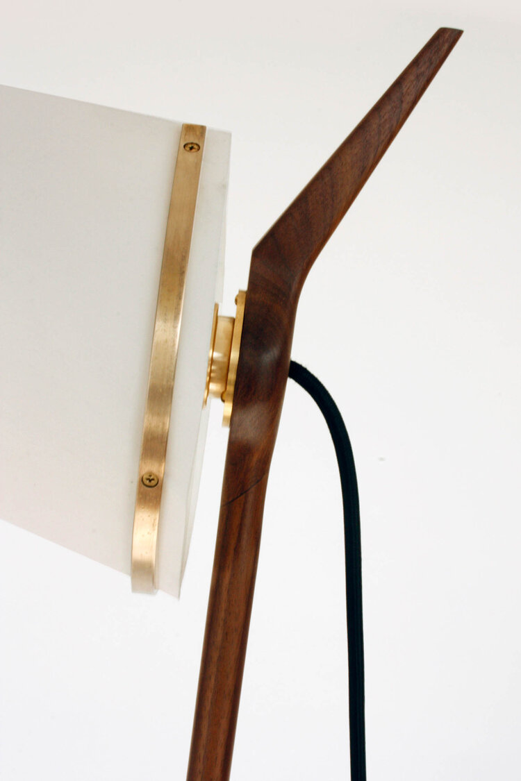 Armitage Floor Lamp - Designed by Edward Armitage in 1952, the Armitage Floor Lamp is made from black walnut. The stem is held at the base by two legs which form a tripod.  The distinctive conical shade is made from recycled felt laminate and its form is supported by a solid brass shade ring.  The lamp is handmade in London, UK. | Matter of Stuff