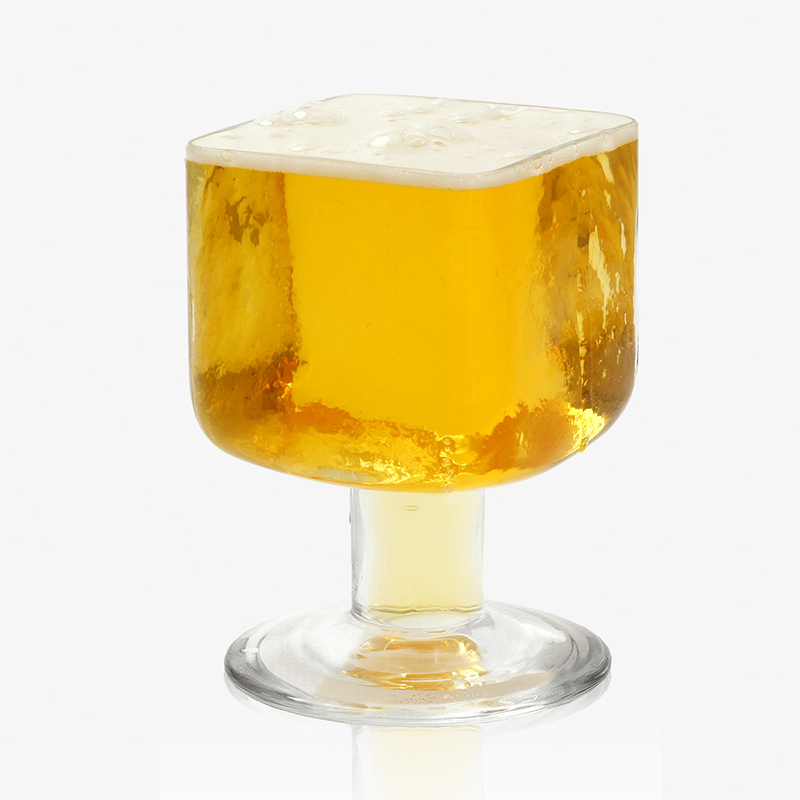 Cubit Beer Glass - Cubit is a hand made beer glass. It's strong cubic form supported by a broad hollow stem makes it one of a kind.