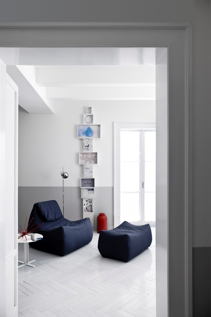 """Valentine Bean Bag - The soft, 70s inspired shapes make the Valentine armchair versatile while maintaining its aesthetic and functional appeal. A very """"solid"""", almost monolithic quality hides an unexpected lightness: one of its main features is the materials chosen for the padding which permit easy transportation of the units. The frame is made using a construction technique of the latest generation. Pre-shaped polystyrene is covered with polyurethane foam, thus conferring lightness and resistance to the units: two fundamental characteristics demanded by the market. Completely removable covers.  Materials Structure in shaped polystyrene covered in spray-applied polyurethane resin on a multi-layer wood base filled with variable-density polyurethane foam and polyester fiber; all covered in a 10% white cotton fabric containing duck/goose down on the seat. Feet in black PVC h 25 mm.   Matter of Stuff"""