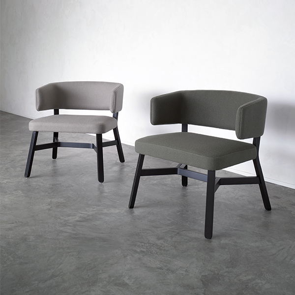 Croissant Lounge Chair - <p>Lounge chair, sofa, bench and pouffe with frame in stained or lacquered beechwood, upholstered. Bench available with total or partial cushion for resting bags and computers.A crucial thought. A refined sense of belonging unites the entire Croissant collection, a recurring design, the crosspiece which distinguishes all the seating, as well as the tables. From the dining table to lounge areas, from restaurant bars and lobbies to privating dining: a complete collection. Chair, armchair, lounge chair, stools, sofa, pouffe and benches in stained or lacquered beechwood, with upholstered seat and back. Tables with frame in stained or lacquered beechwood and top in lacquered or laminated mdf or compact laminate.</p>  | Matter of Stuff