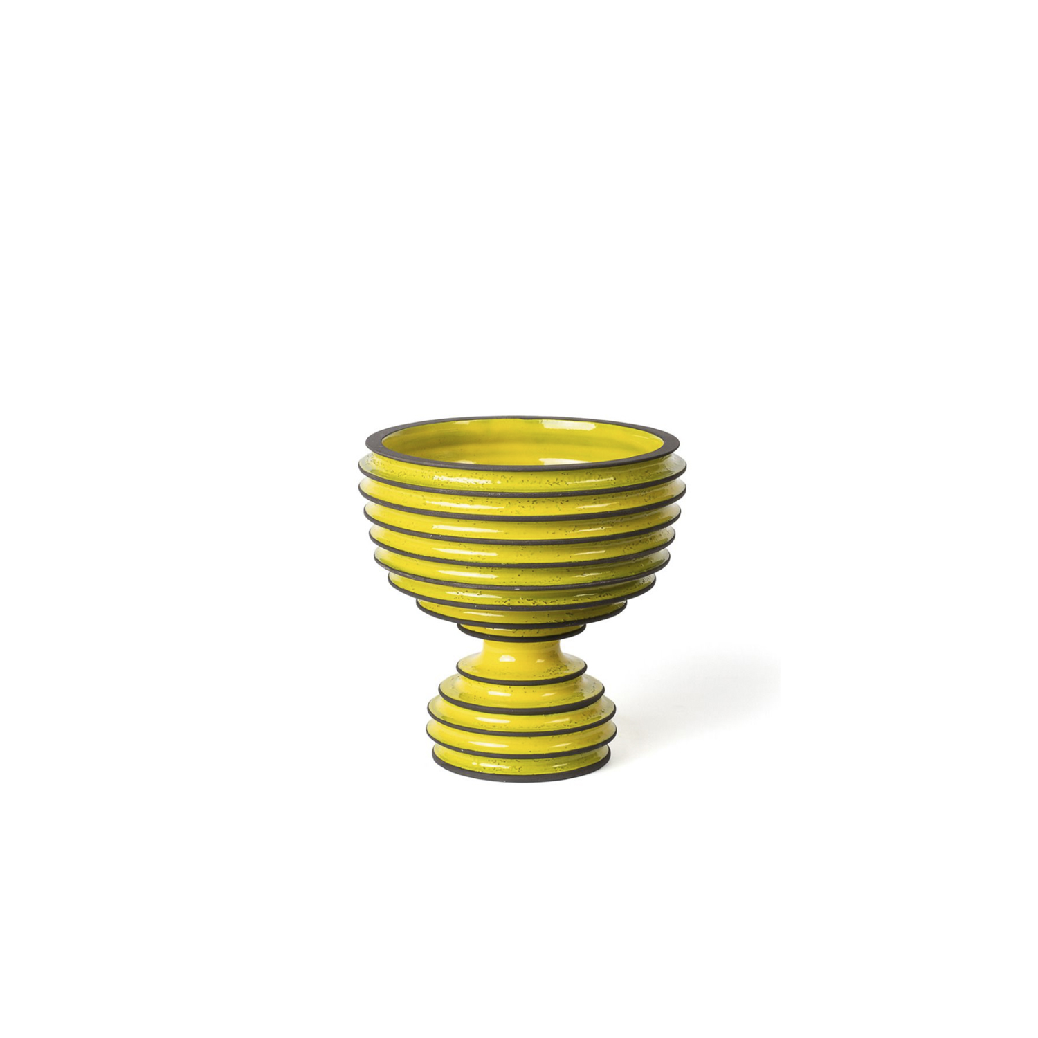 Yellow Footed Bowl - A traditional design dressed in a stylish contemporary suite, this ceramic goblet is part of the exclusive Revolver Collection, showcased at Milan Design Week in 2019. The hourglass-shaped, orange-hued silhouette features a spacious bowl resting on a convex base, both distinguished by a deeply ribbed texture accented by brown edges. | Matter of Stuff