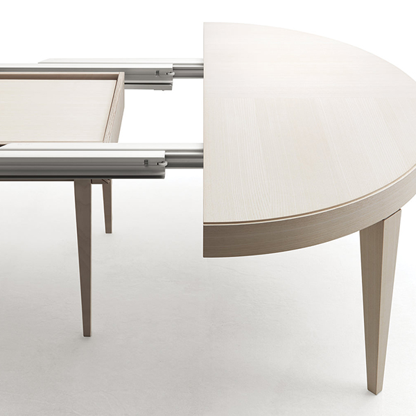 "Edo Tondo Round Extendable Table - <p>Characterised by sober elegance and harmony in shape and lines, ""Edo tondo"" easily fits the different kinds of domestic environment. Its ability and ease of extension allows a quick usage, solving every situation, even the most unexpected one.</p>