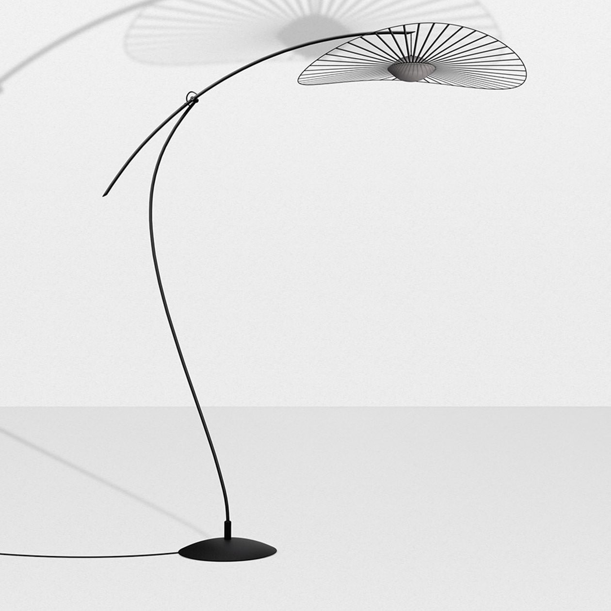 Vertigo Nova Floor Light - Petite Friture and Constance Guisset, an inseparable duo with lofty ambitions, have started a new chapter of the Vertigo story with Vertigo Nova: a highly technical piece of sophisticated design.  The collection includes items, from table and floor lamps to suspension and wall lights, all available in either black or white. The vast veil of graphic lines mounted atop a sphere of handblown glass uses built-in LED technology to emit a soft light.  Vertigo Nova quivers as the geometric curve of the fiberglass hoop. Installed by hand by qualified French artisans and held delicately but firmly in place by taught ribbons, reacts to the lightest of breezes.  Vertigo Nova is the epitome of striking a balance between technology and elegance. | Matter of Stuff