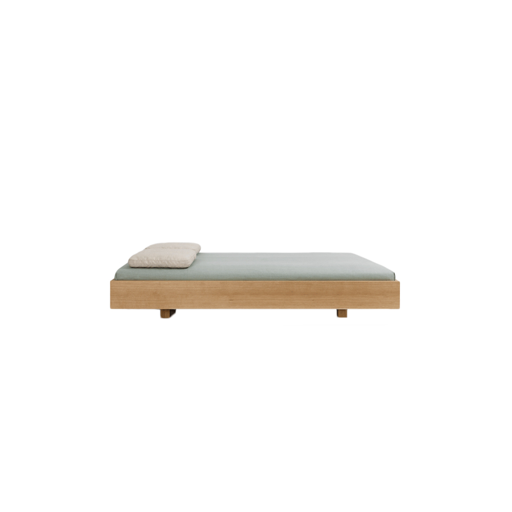 Simple Bed  - The puristic design of SIMPLE foregrounds the living material. The lightness of the construction is intensified by the floating frame. SIMPLE – the bed in the simplest form and function. The bedside tables DEPO, DOZY and WAITER & WAITRESS are the perfect accompaniments.  The simple bed is available in white oiled ash, oiled oak, oiled knotty oak, colour stained oak, oiled American cherry, oiled American walnut and oiled European walnut. Available in special sizes(L190, 210, 220 cm) and comfort height 40 cm | bedside and feet each heightened 4 cm at an additional charge upon request.   For colour stained oak options, please refer to the catalogue.  | Matter of Stuff