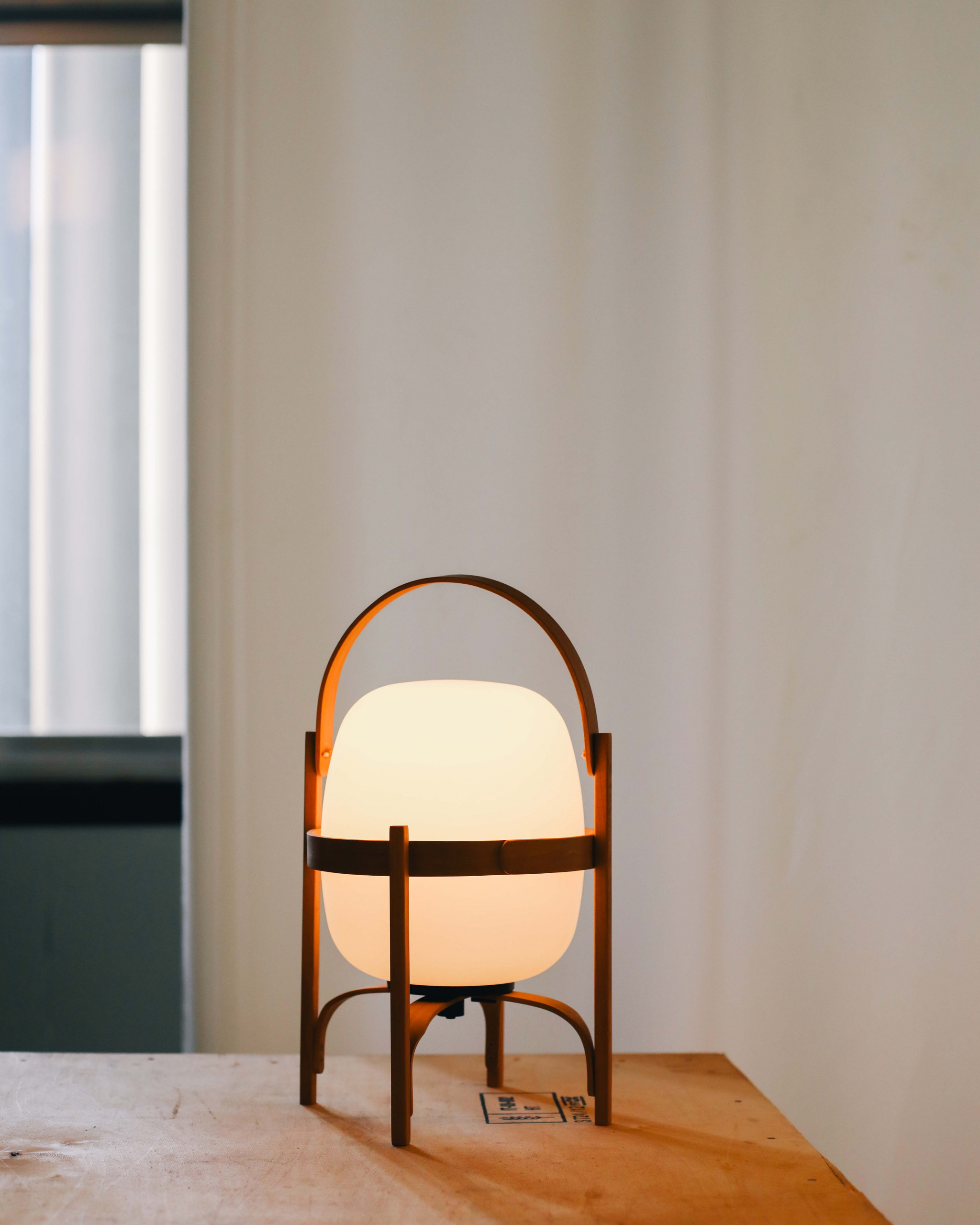 Cestita Bateria Table Lamp - <p>Cestita Batería is the new member of the Cesta family: a portable, cordless version. As with all of Milá's objects, this version champions industrial craftsmanship, by combining functionalism and the legacy of local artisan creation. With this new version, the lamp's features are enhanced with the help of technology. Keeping with the family's warmth and spirit, it features an opal glass shade supported by a beautiful cherry wooden structure. Includes charger. To prevent wood degradation, the lamp should not be left outdoors permanently.</p>    Matter of Stuff