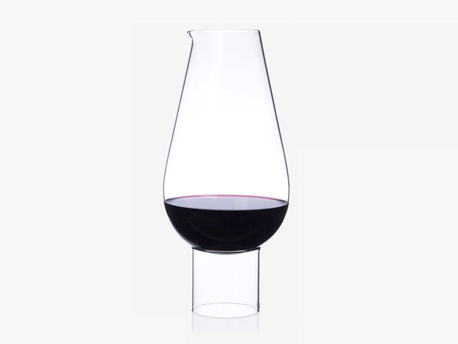 Hybrid Wine | Water Carafe | Vase - A hybrid vessel that is both wine carafe or water jug, sometimes even a flower vase. The design contains featuresfrom the worlds of both stemware and serving glass that makes it feel at home on almost any table.  | Matter of Stuff
