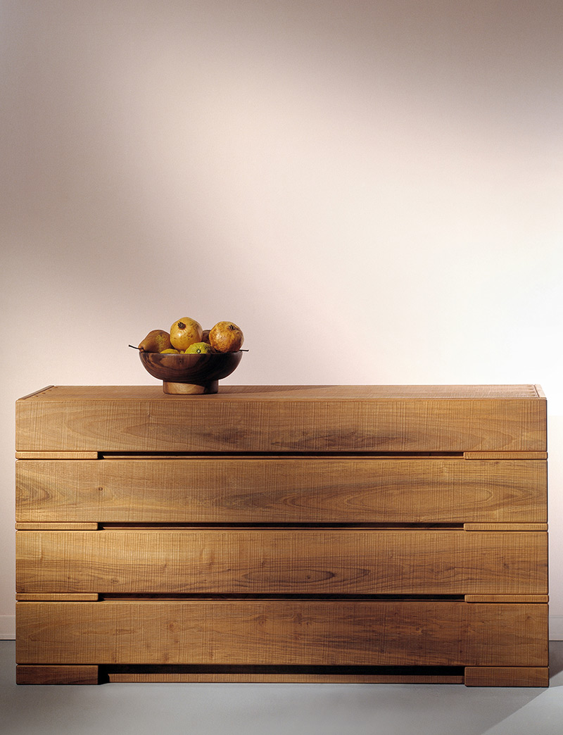 """Aurora Chest Of Drawers - <p>Aurora is a four-drawer storage unit made in solid wood. Its is manually finished on all sides using a plane.<br /> The entire manufacturing and finishing process is carried out manually in our workshop. The wood used for this piece is Juglans Regia – common Italian walnut; not dried but """"raw"""". This wood belongs to the Latin tradition of furniture-making and features an extremely compact fibre which can, however, be worked without too much difficulty; it is therefore highly suitable for household items. Over time the wood hardens and becomes extremely resistant, and oxidises slightly to take on a progressively warmer amber colour. Customise and made with Linden wood, European cherry, Slavonian oak, maple.</p>  