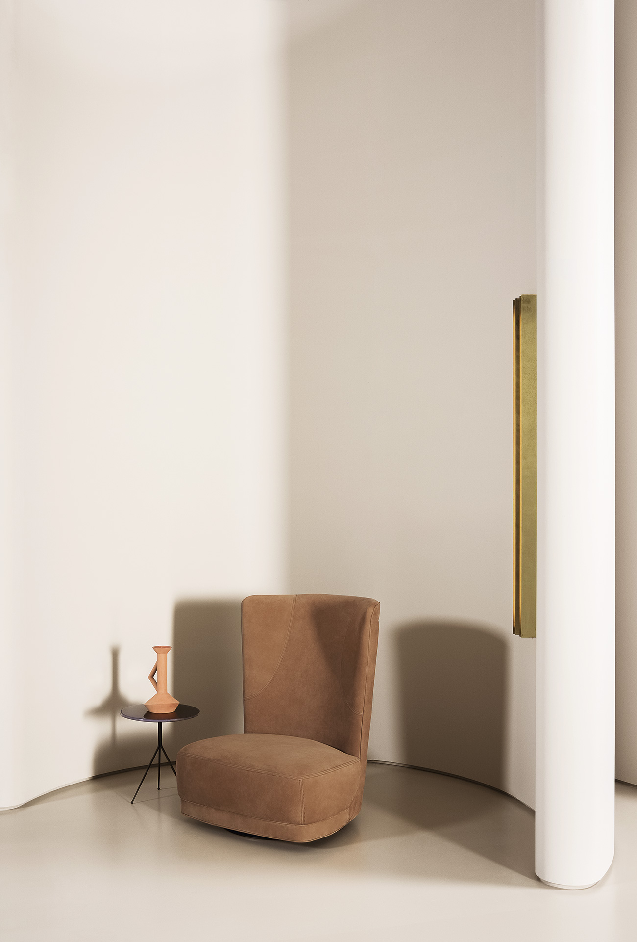 Etienne Bergere Revolving Armchair - Backrest frame in curved plywood and seat in pine and beech. Padding in differentiated density polyurethane foam. Double decorative edge. Matte black-varnished metal revolving base.  The armchair with two different kinds of leather or colour (structure and seat) is available on request with no surcharge; it should be remembered that the price is set by the leather in the higher category.  Each product is hand-made in Italy and upholstery can be customised upon request. For more information on leathers and materials please refer to the catalogue   Matter of Stuff